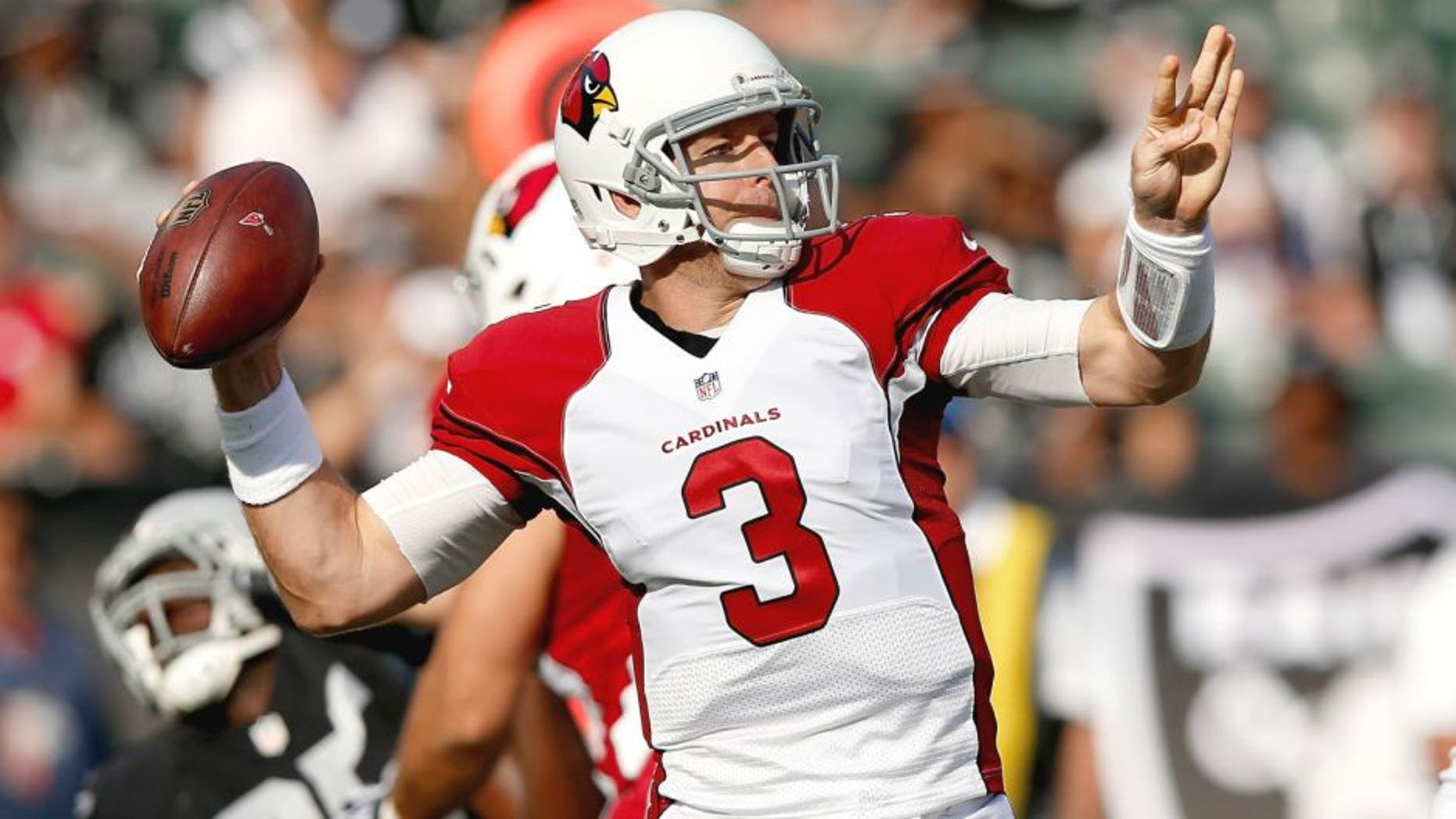 OAKLAND, CA - AUGUST 30: Carson Palmer #3 of the Arizona Cardinals throws the ball against the Oakland Raiders at O.co Coliseum on August 30, 2015 in Oakland, California. (Photo by Ezra Shaw/Getty Images)