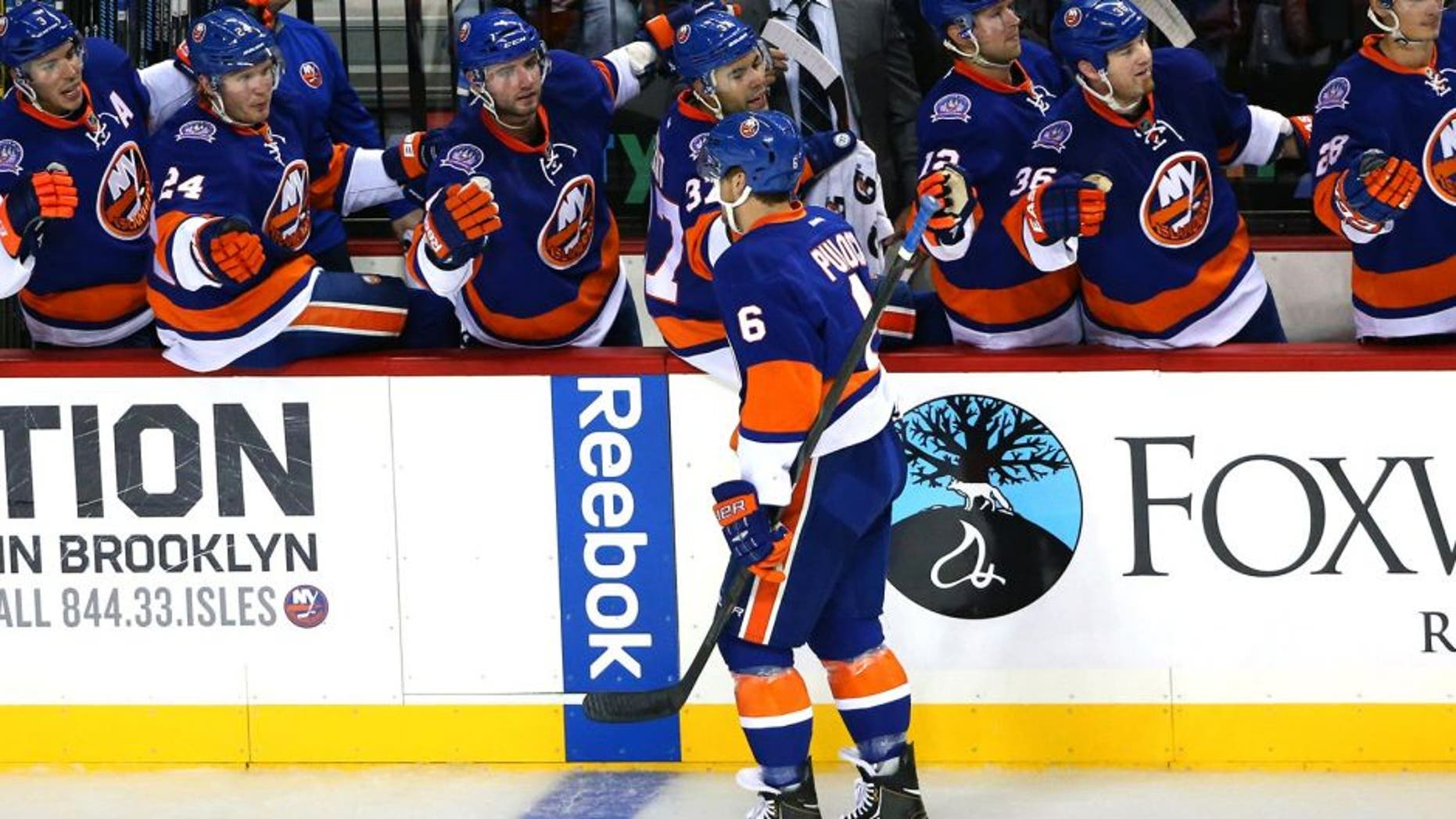Sep 26, 2014; Brooklyn, NY, USA; New York Islanders defenseman Ryan Pulock (6) high fives the bench after scoring during the first period against the New Jersey Devils at Barclays Center. Mandatory Credit: Anthony Gruppuso-USA TODAY Sports