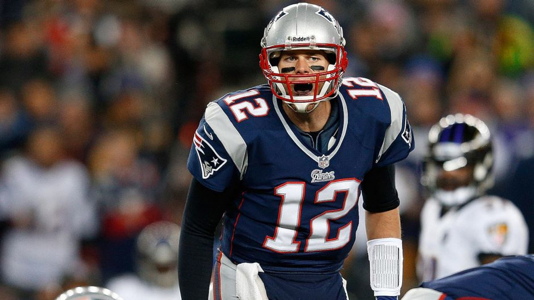 FOXBORO, MA - JANUARY 20: Tom Brady #12 of the New England Patriots makes an adjustment at the line against the Baltimore Ravens during the 2013 AFC Championship game at Gillette Stadium on January 20, 2013 in Foxboro, Massachusetts. (Photo by Jim Rogash/Getty Images)