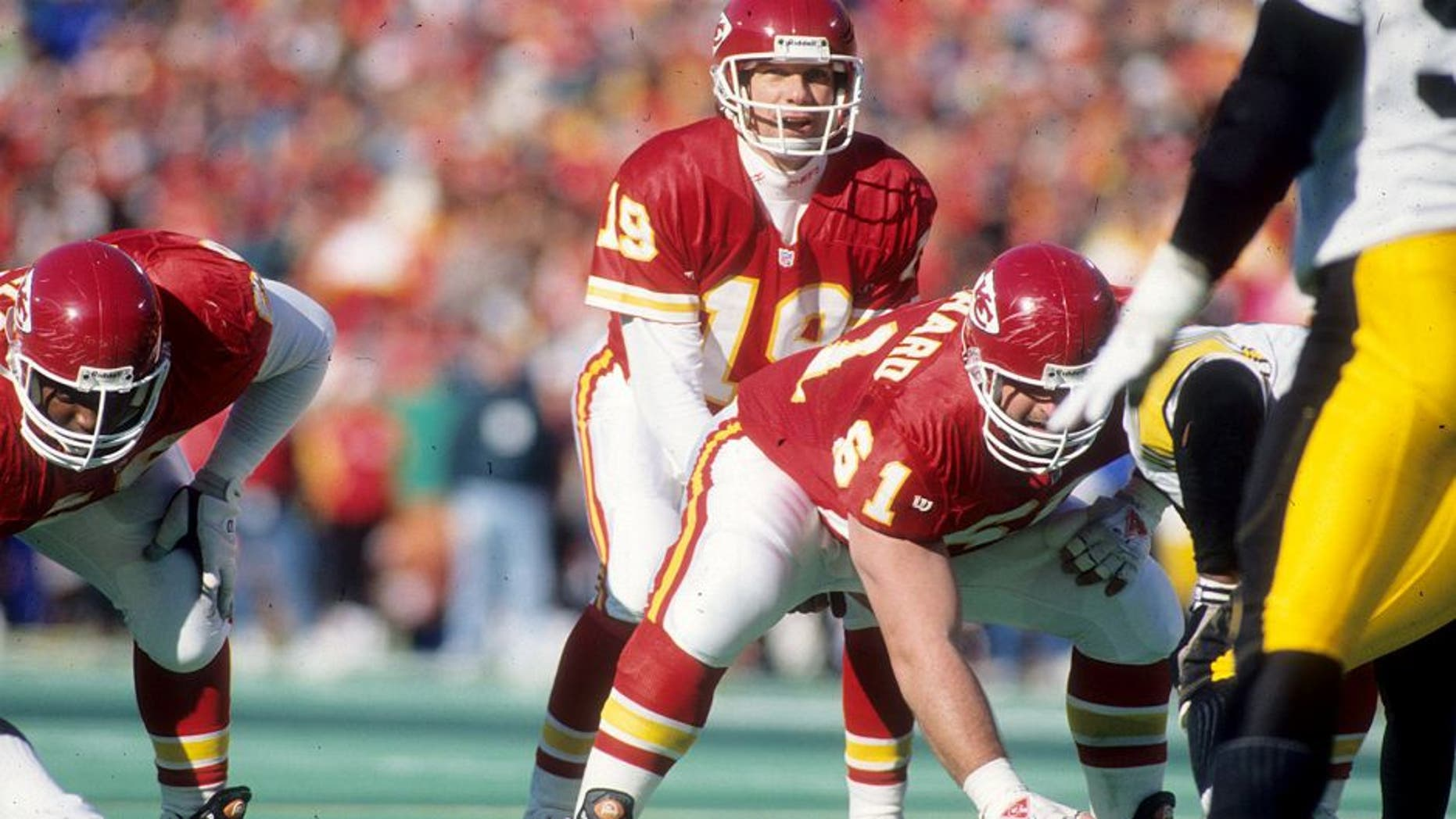 KANSAS CITY, MO - JANUARY 8: Quarterback Joe Montana #19 of the Kansas City Chiefs prepares to take the snap from center Tim Grunhard #61 against the Pittsburgh Steelers in the 1993 AFC Wild Card Game at Arrowhead Stadium on January 8, 1994 in Kansas City, Missouri. The Chiefs defeated the Steelers 27-24 in overtime. (Photo by Joseph Patronite/Getty Images)