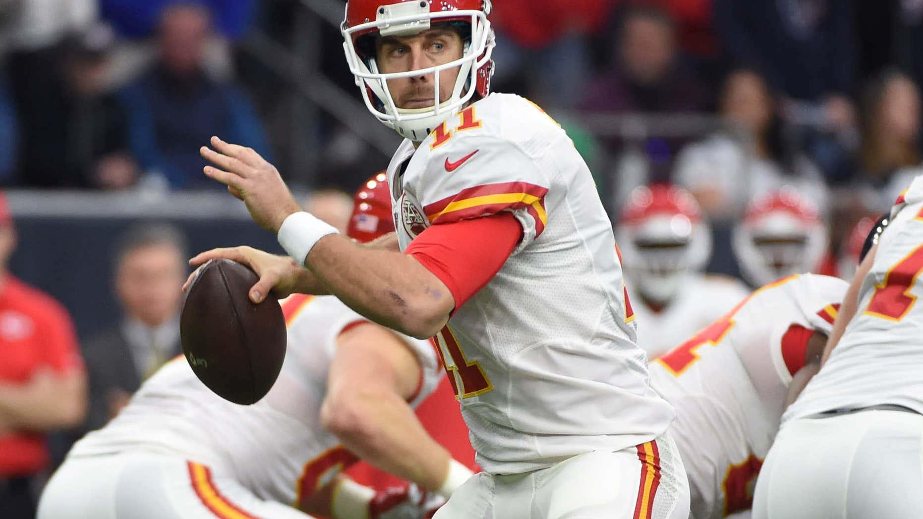 Kansas City Chiefs quarterback Alex Smith (11) looks to throw against the Houston Texans during the first half of an NFL wild-card football game Saturday, Jan. 9, 2016, in Houston.