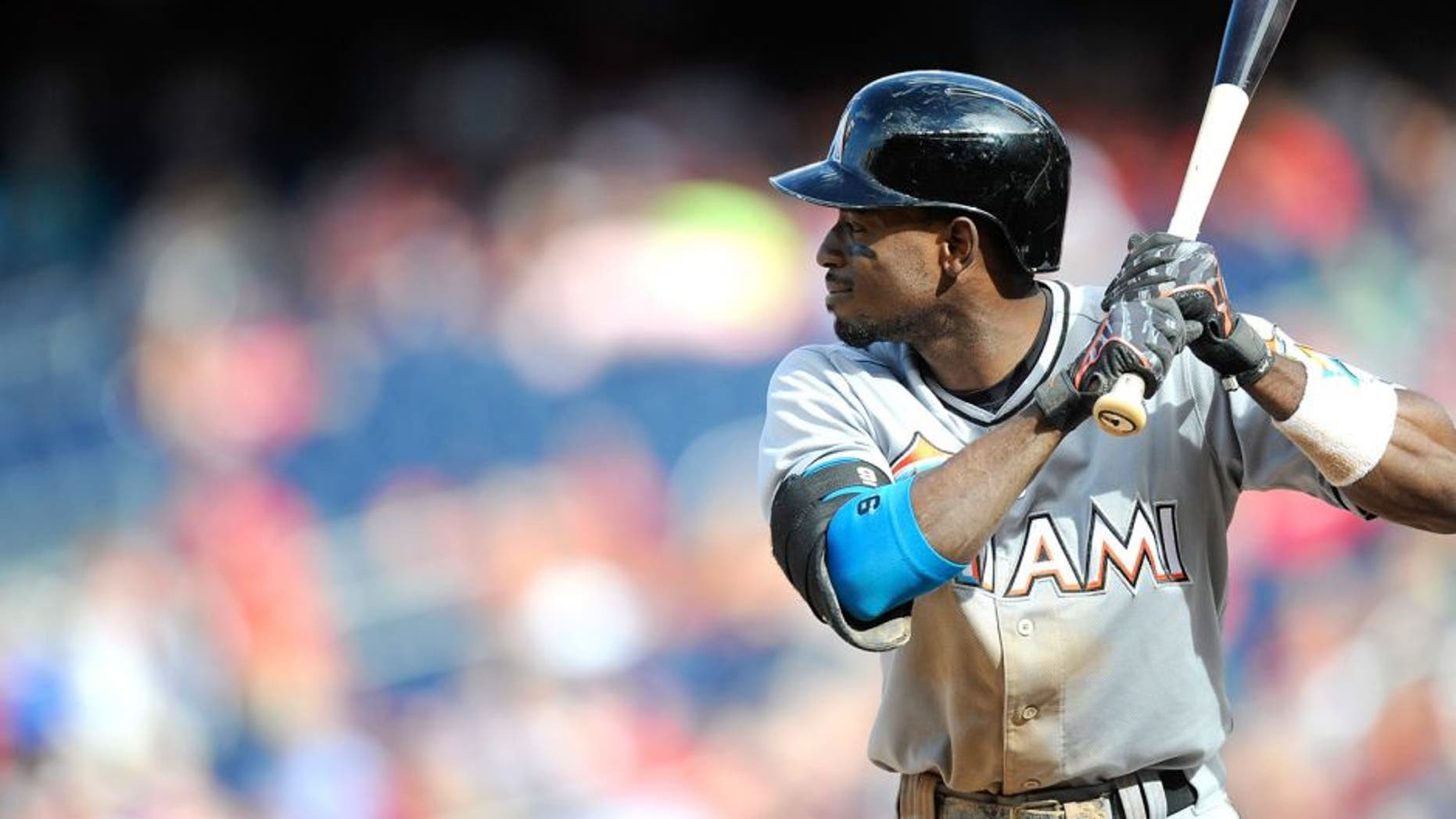 WASHINGTON, DC - SEPTEMBER 20: Dee Gordon #9 of the Miami Marlins bats against the Washington Nationals at Nationals Park on September 20, 2015 in Washington, DC. (Photo by G Fiume/Getty Images)