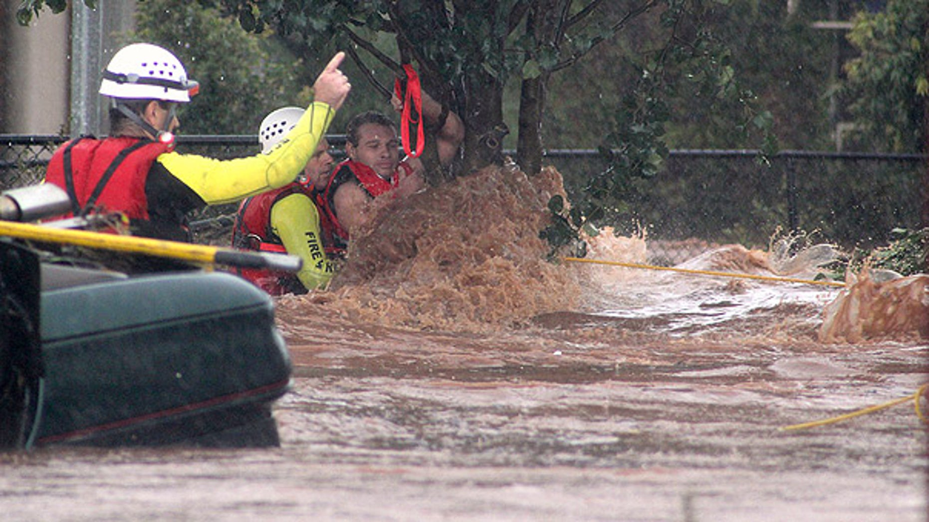 Jan. 10: A man is rescued by emergency workers after he was stranded clinging to a tree during a flash flood in Toowoomba, Australia.