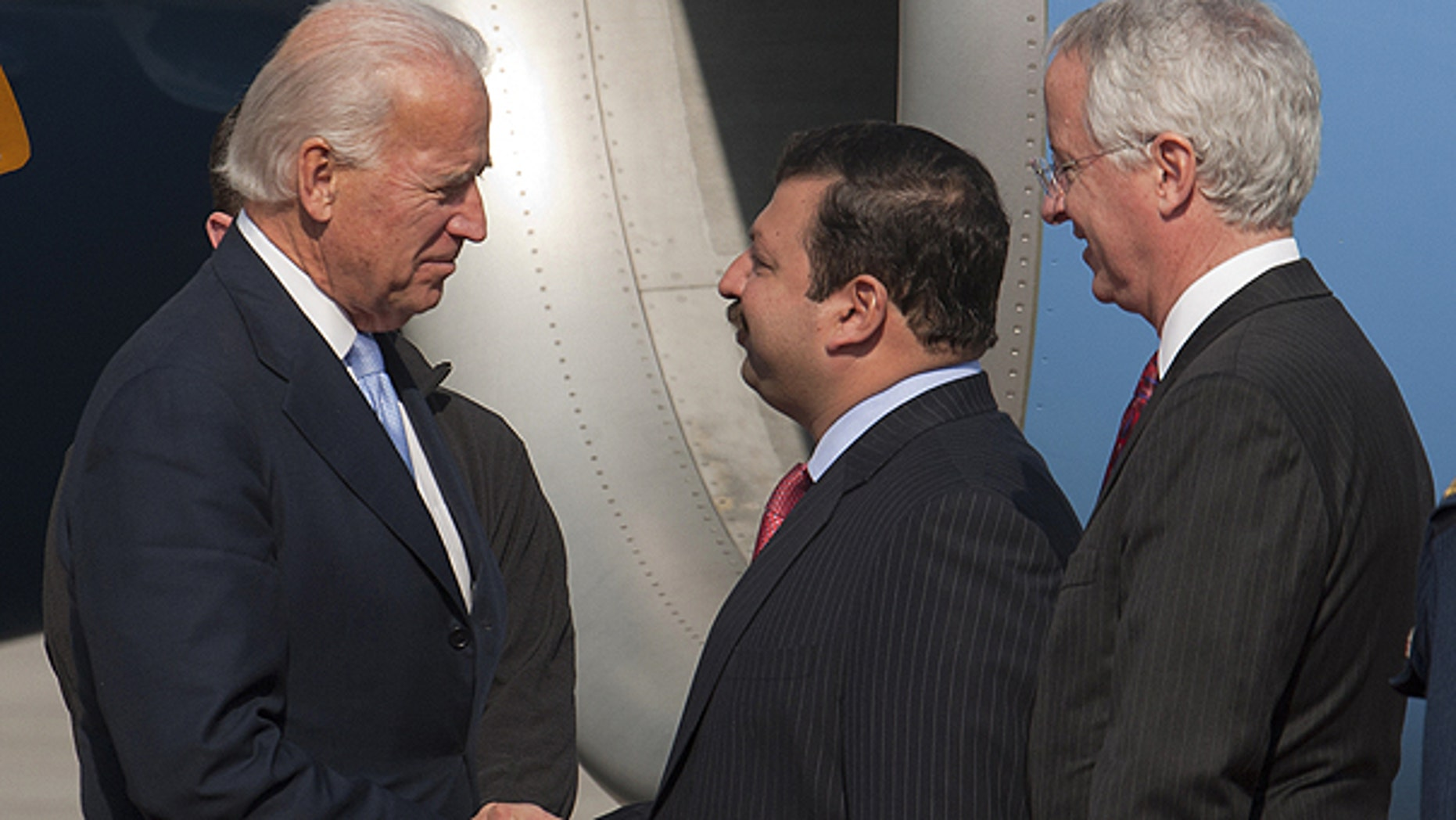Jan. 12: U.S. Vice President Joe Biden, left, is welcomed by Pakistani Minister of State for Foreign Affairs Nawabzada Malik Amad Khan and U.S. Ambassador to Pakistan Cameron Munter, right, upon his arrival at airforce base in Rawalpidi, Pakistan.
