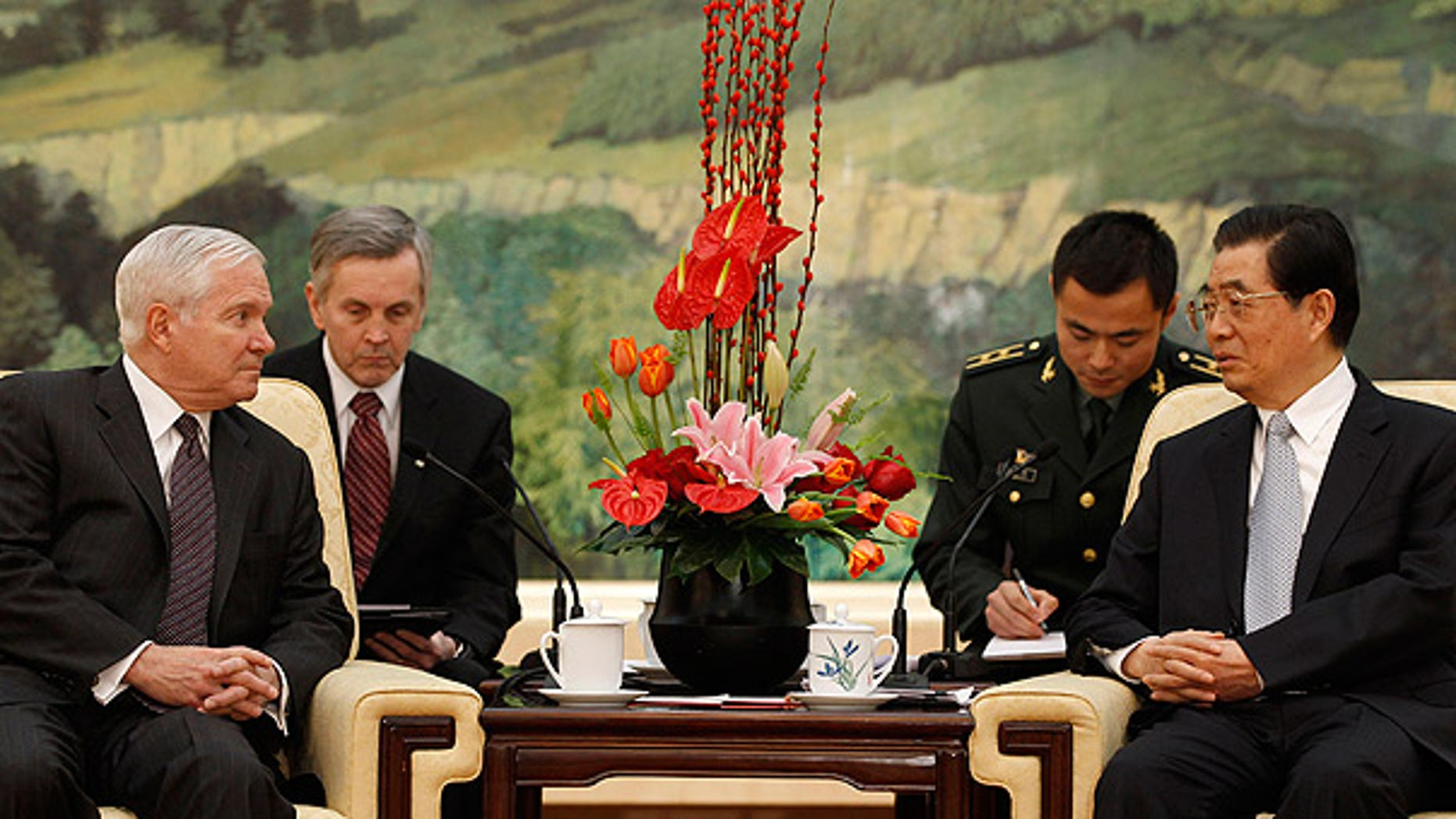 Jan. 11: Secretary of Defense Robert Gates, left, listens to Chinese President Hu Jintao during a meeting at the Great Hall of the People in Beijing.