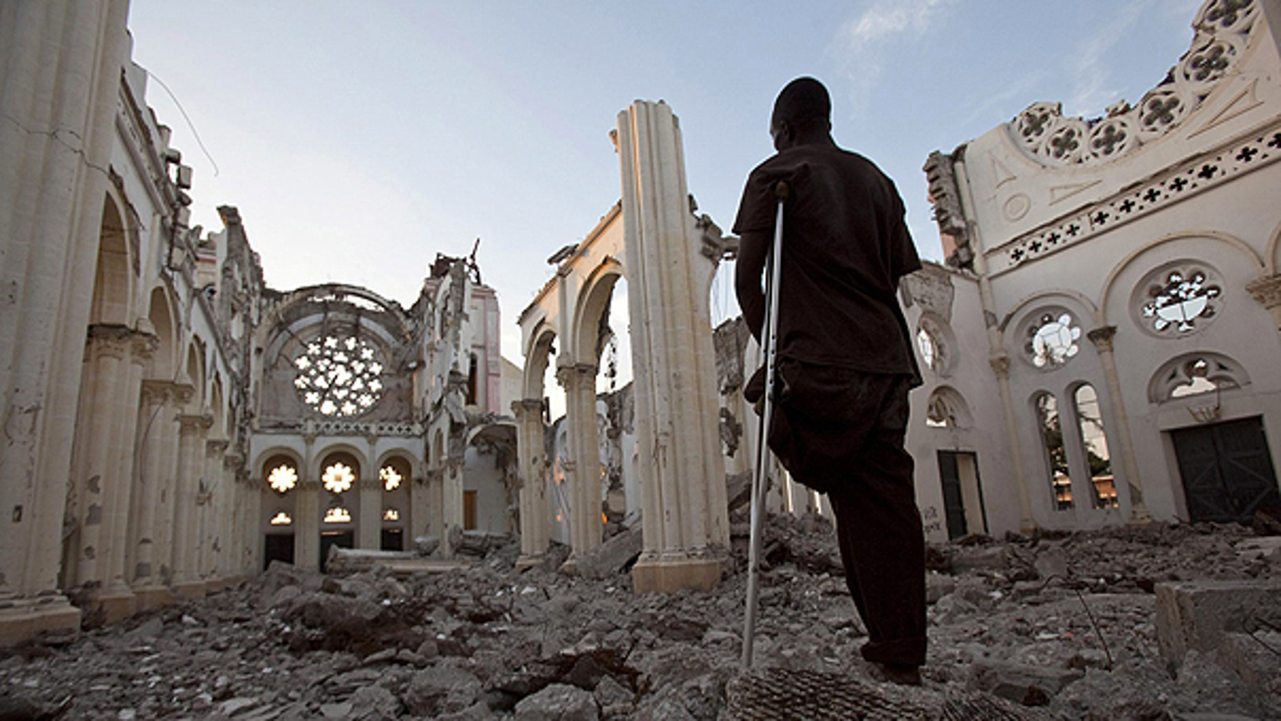 Jan. 11: Icaris Celnet stands in the ruins of The Cathedral of Our Lady of the Assumption, often called Cathédrale de Port-au-Prince in Port-au-Prince, Haiti, on the eve of the first anniversary of the earthquake that killed more than 200,000 people and displaced some 1.5 million more.