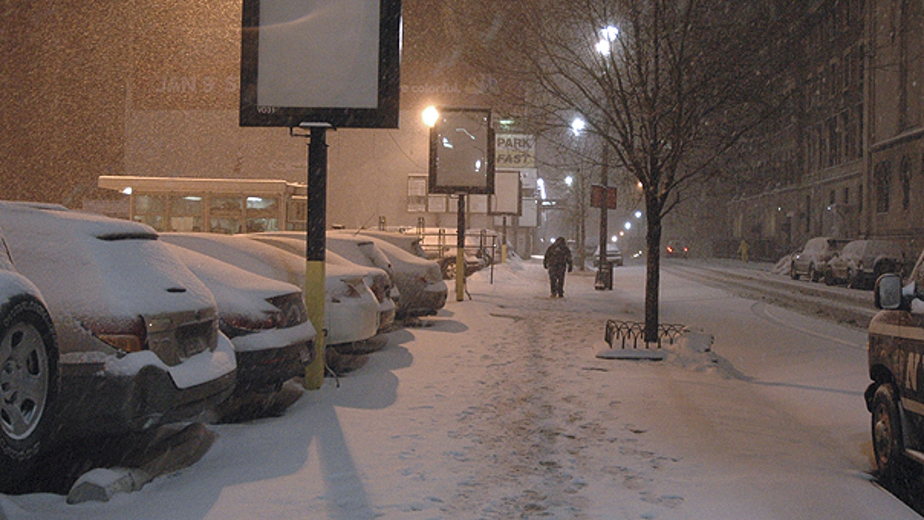 Jan. 12: A man trudges down a snow-covered sidewalk in New York.