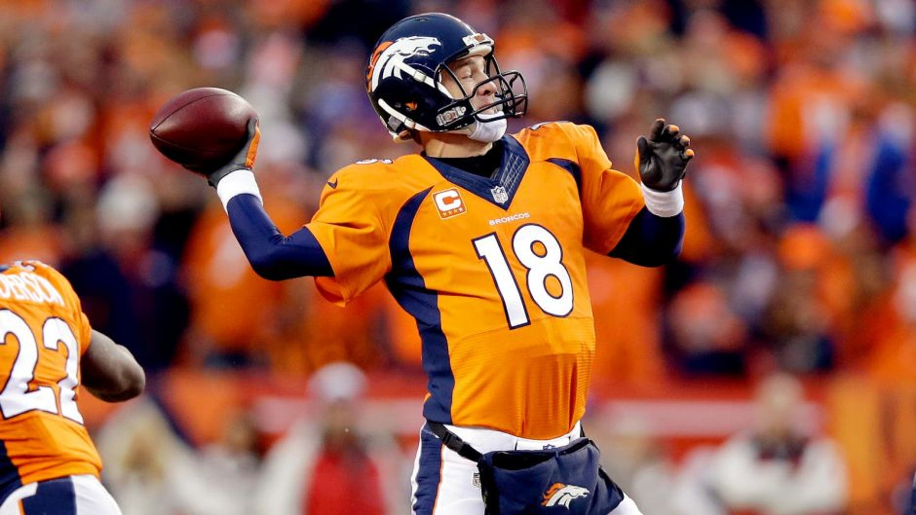 Peyton Manning #18 of the Denver Broncos passes against the Indianapolis Colts during a 2015 AFC Divisional Playoff game at Sports Authority Field at Mile High on January 11, 2015 in Denver, Colorado. (Photo by Ezra Shaw/Getty Images)