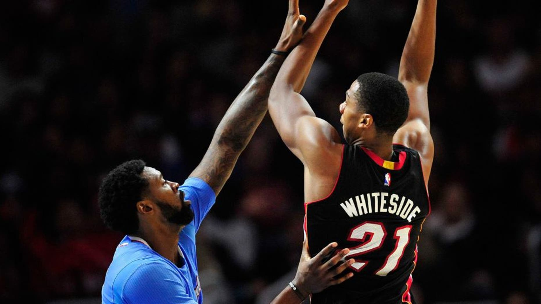 January 11, 2015; Los Angeles, CA, USA; Miami Heat center Hassan Whiteside (21) shoots against the defense of Los Angeles Clippers center DeAndre Jordan (6) during the second half at Staples Center. Mandatory Credit: Gary A. Vasquez-USA TODAY Sports