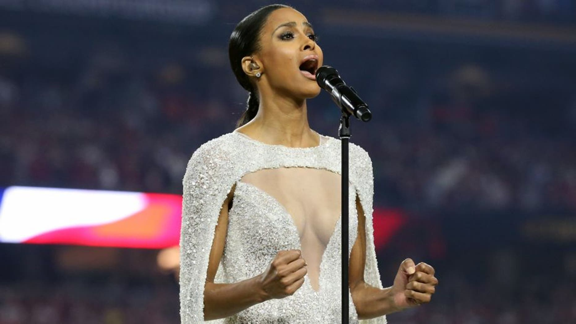 Jan 11, 2016; Glendale, AZ, USA; Recording artist Ciara sign the National Anthem prior to the game between the Alabama Crimson Tide and the Clemson Tigers in the 2016 CFP National Championship at University of Phoenix Stadium. Mandatory Credit: Matthew Emmons-USA TODAY Sports