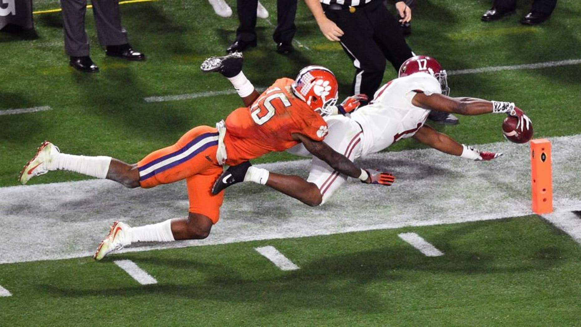 Jan 11, 2016; Glendale, AZ, USA; Alabama Crimson Tide running back Kenyan Drake (17) scores a touchdown while guarded by Clemson Tigers safety T.J. Green (15) during the fourth quarter in the 2016 CFP National Championship at University of Phoenix Stadium. Mandatory Credit: Gary A. Vasquez-USA TODAY Sports