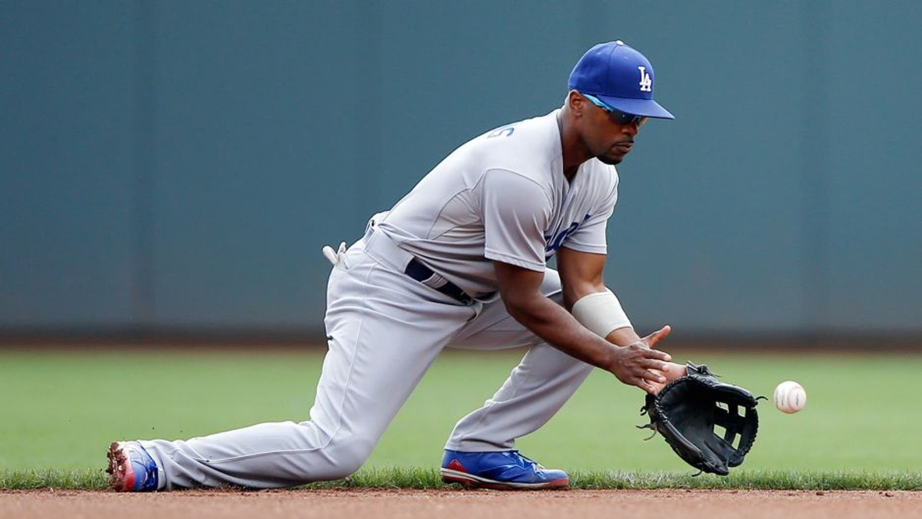 CINCINNATI, OH - AUGUST 27: Jimmy Rollins #11 of the Los Angeles Dodgers fields a ground ball against the Cincinnati Reds during a game at Great American Ball Park on August 27, 2015 in Cincinnati, Ohio. The Dodgers defeated the Reds 1-0. (Photo by Joe Robbins/Getty Images)