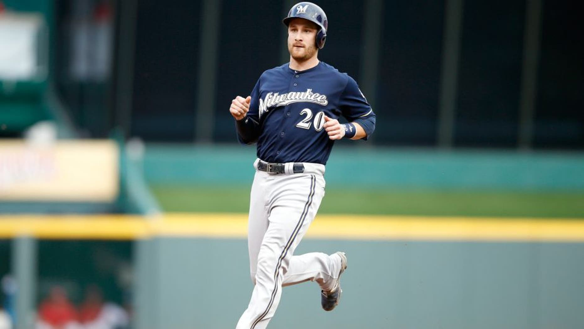CINCINNATI, OH - JULY 3: Jonathan Lucroy #20 of the Milwaukee Brewers runs the bases against the Cincinnati Reds during the game at Great American Ball Park on July 3, 2015 in Cincinnati, Ohio. The Brewers defeated the Reds 12-1. (Photo by Joe Robbins/Getty Images)