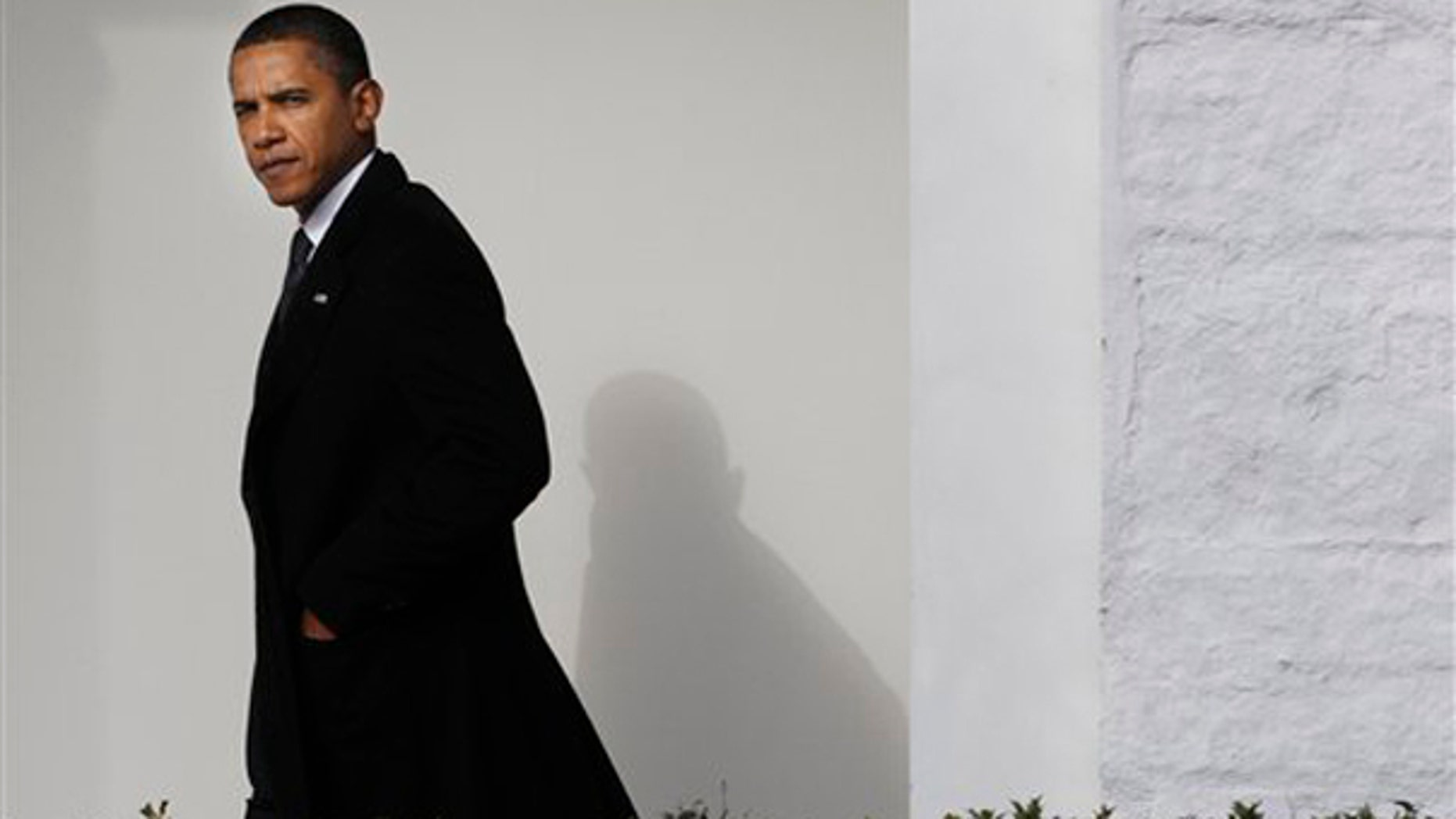 President Barack Obama walks back to the Oval Office of the White House in Washington, Tuesday, Jan. 12, 2010, after traveling to Delaware to attend the funeral services for Jean Biden, mother of Vice President Joe Biden. (AP Photo/Pablo Martinez Monsivais)