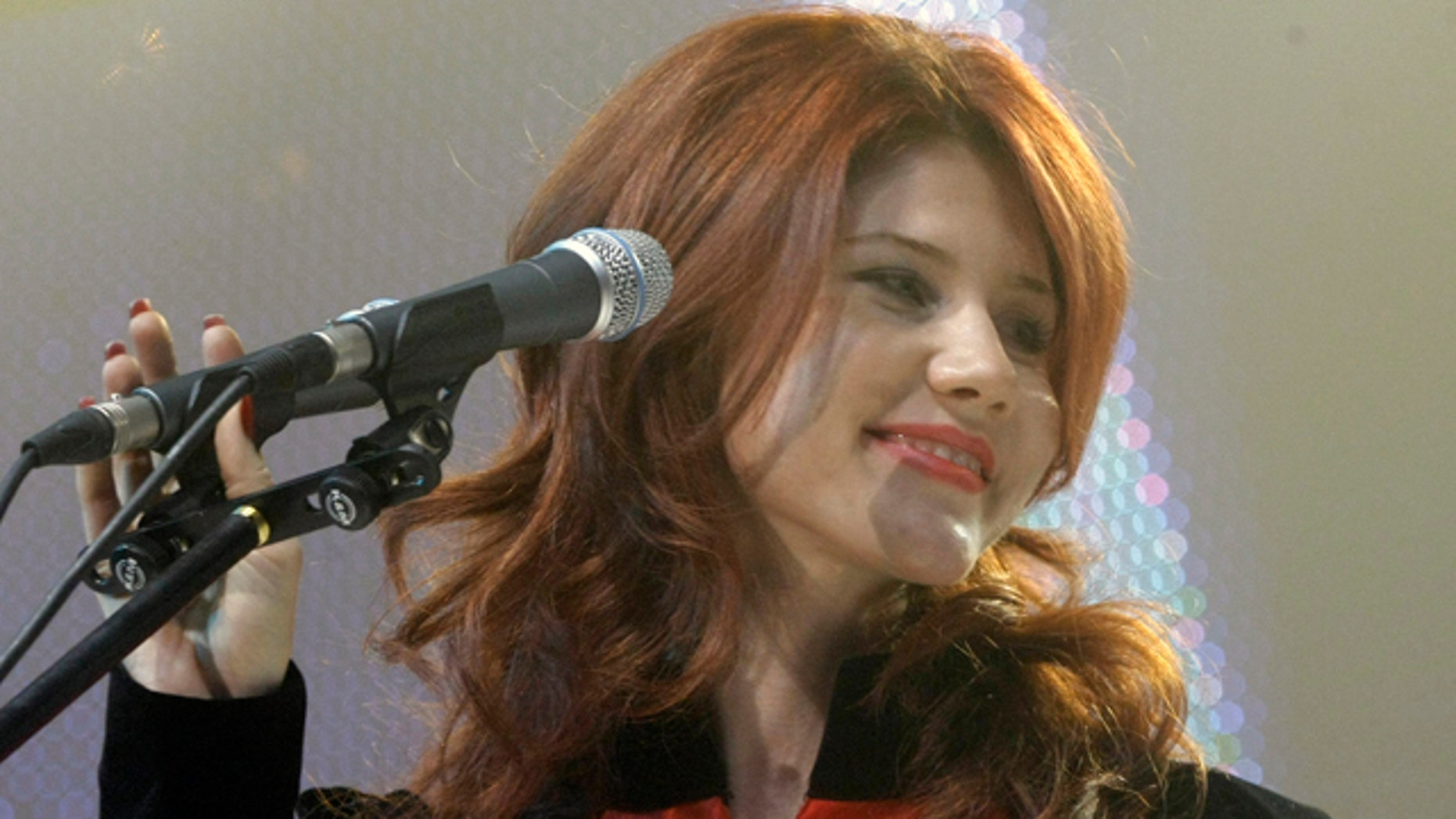 Anna Chapman, who was deported from the U.S. on charges of espionage, is on stage with the leaders of Young Guards, a pro-Kremlin youth movement she joined, in Moscow, Russia, Wednesday, Dec. 22, 2010.