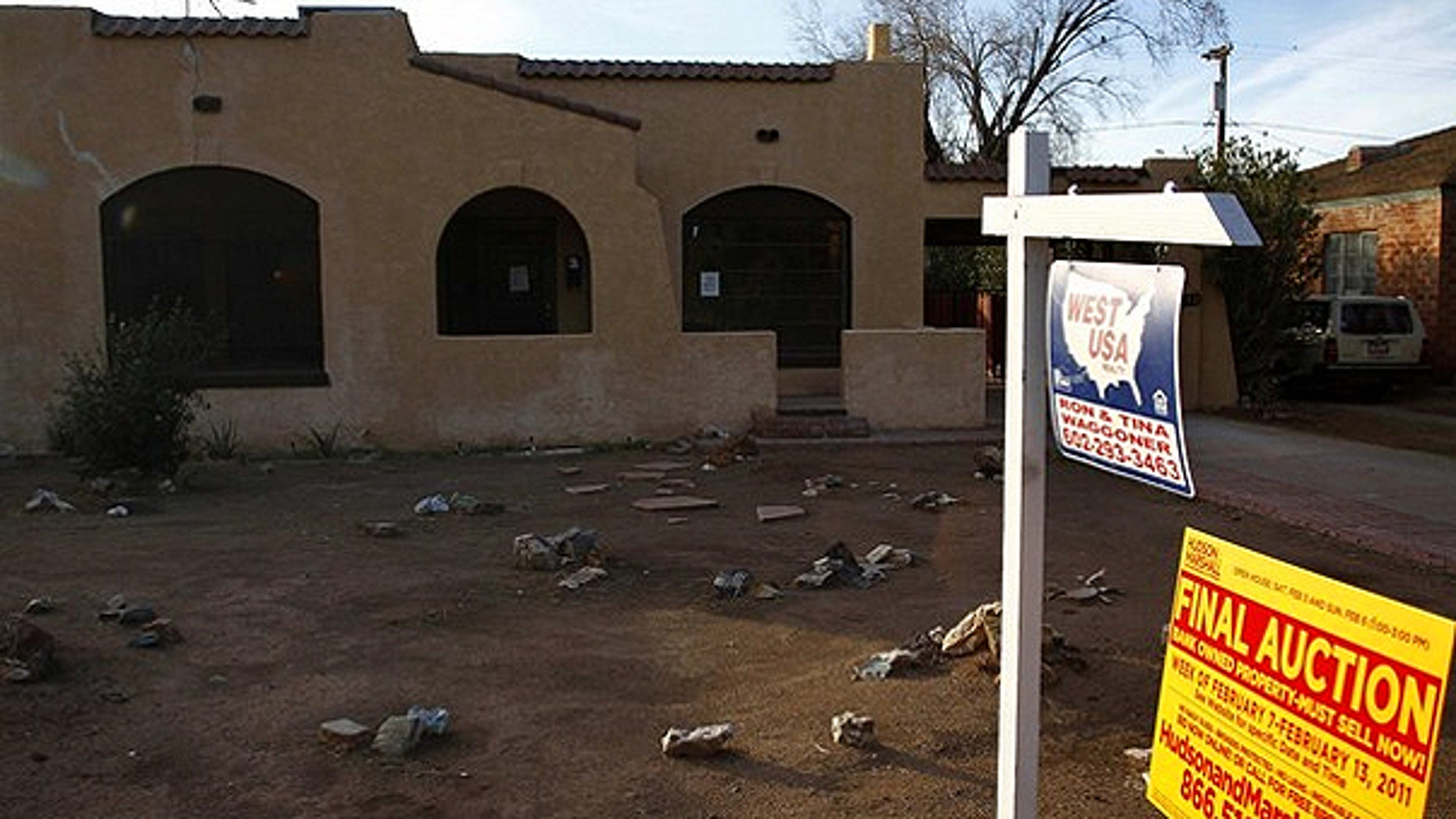 Jan. 4: A realtor and bank-owned sign is displayed near a house for sale in Phoenix, Arizona.