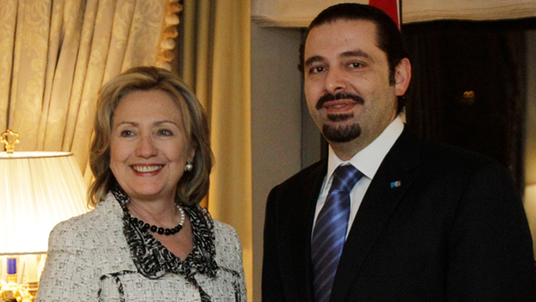 Jan. 7: Lebanese Prime Minister Saad Hariri, right, shakes hands with Secretary of State Hillary Rodham Clinton in New York.