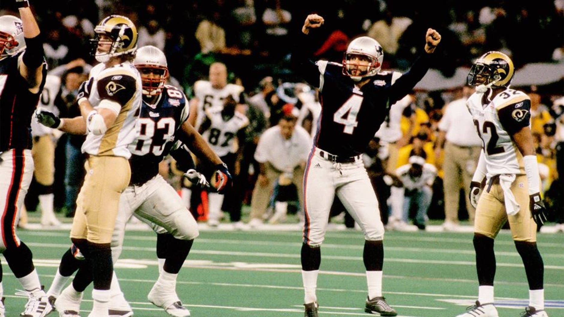 New England Patriots kicker Adam Vinatieri (4) celebrates his 48-yard game-winning kick during Super Bowl XXXVI, a 20-17 victory over the St. Louis Rams on February 3, 2002, at the Louisiana Superdome in New Orleans, Louisiana. (Photo by Sylvia Allen/Getty Images)