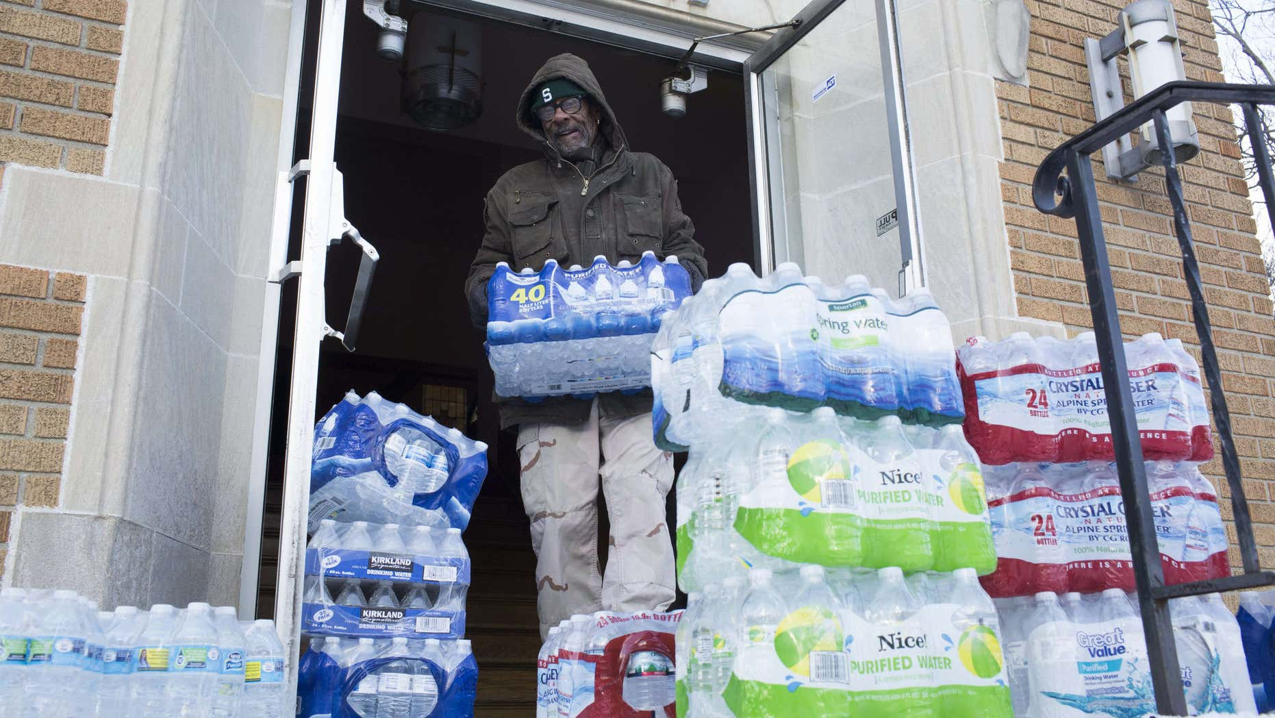 Jan. 11, 2016: Maurice Rice organizes cases of water at the Joy Tabernacle Church in Flint, Mich.