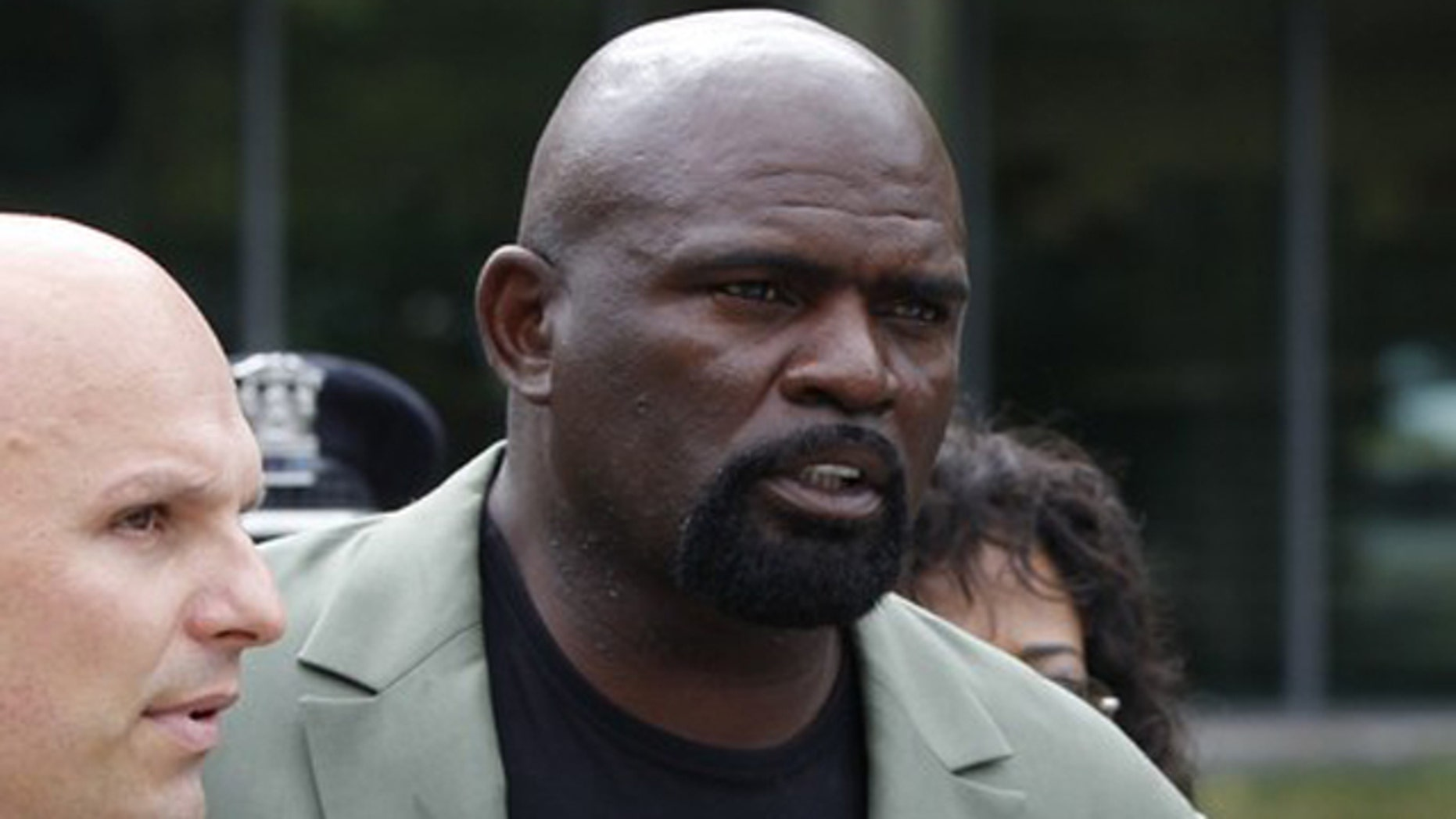 Former NFL football player Lawrence Taylor leaves Rockland County Court with his attorney Arthur Aidala after pleading not-guilty to third-degree rape charges after his arraignment in New City, New York, July 13, 2010.