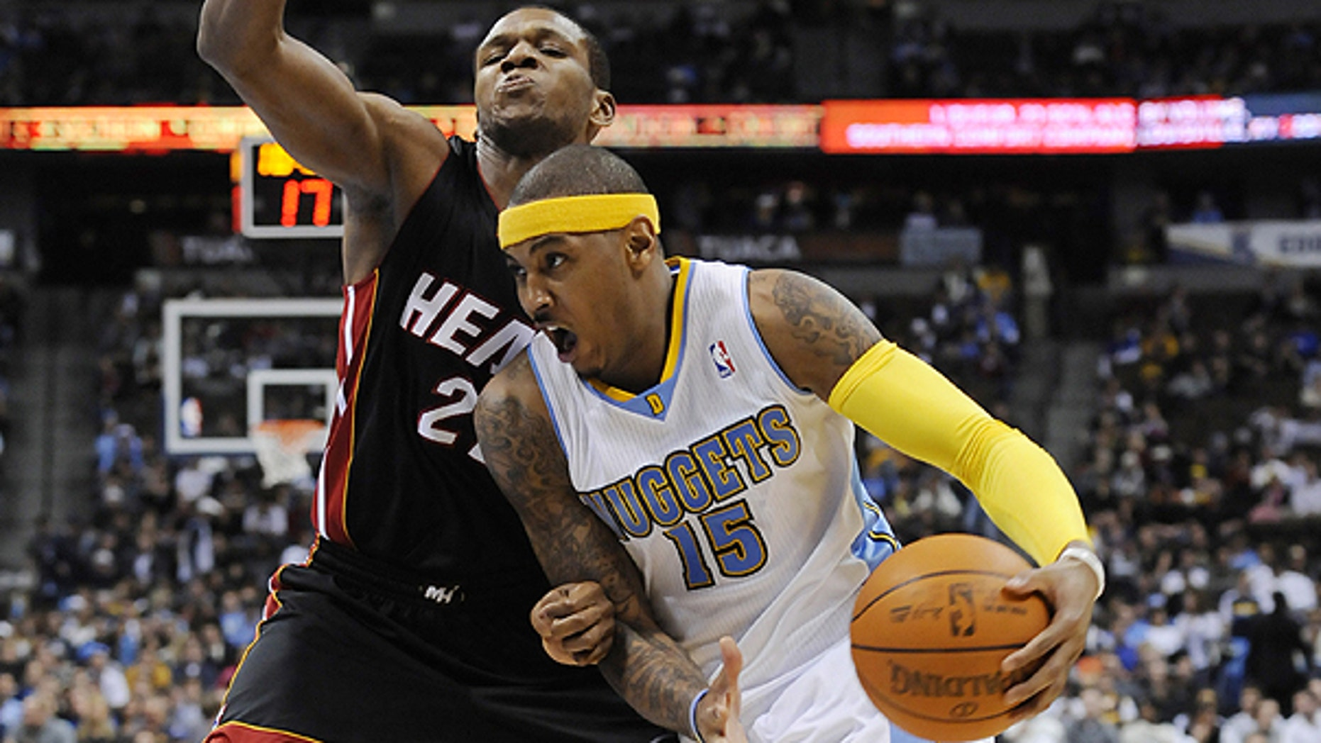 Jan. 13: Denver Nuggets forward Carmelo Anthony (15) drives past Miami Heat forward James Jones (22) during the third quarter of an NBA basketball game in Denver.