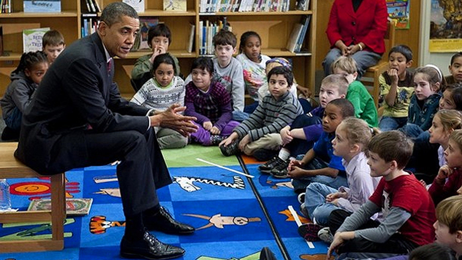 Dec. 17: President Obama talks with students after reading the book 'Twas the Night Before Christmas,' at Long Branch Elementary School in Arlington, Virginia.