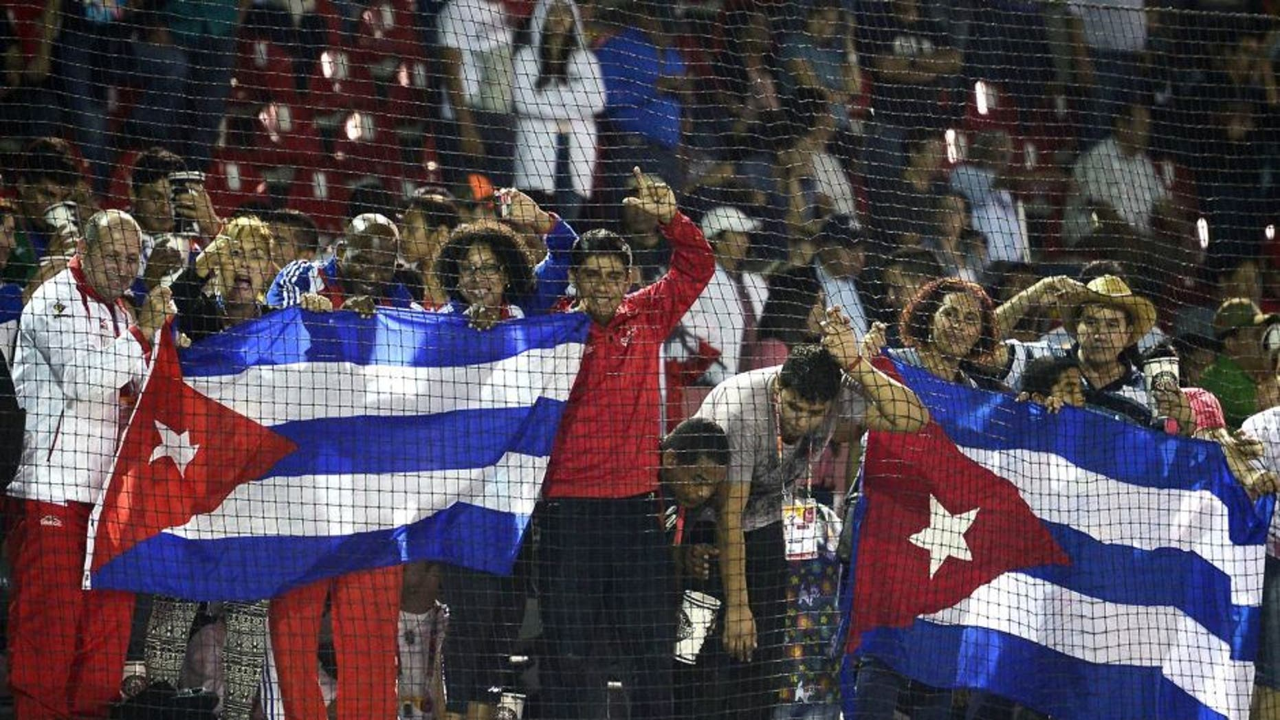 Cuban fans celebrate after winning the Gold medal against Nicaragua during the final match of Baseball, at the XXII Central American and Caribbean Games, in Veracruz, Mexico, on November 21, 2014. The Games bring together nearly 8,000 athletes from 31 countries and run through November 30. AFP PHOTO/RONALDO SCHEMIDT (Photo credit should read RONALDO SCHEMIDT/AFP/Getty Images)