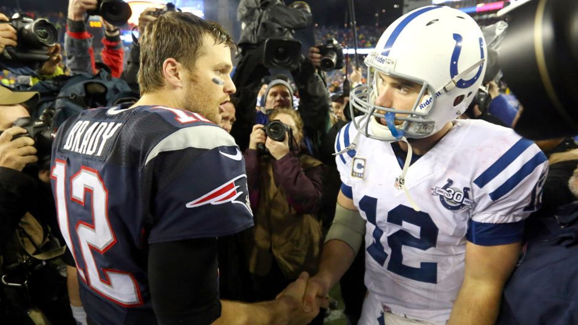 FOXBORO, MA - JANUARY 11: (L-R) Tom Brady #12 of the New England Patriots shakes hands with Andrew Luck #12 of the Indianapolis Colts after their AFC Divisional Playoff game at Gillette Stadium on January 11, 2014 in Foxboro, Massachusetts. The New England Patriots defeated the Indianapolis Colts 43 to 22. (Photo by Al Bello/Getty Images)
