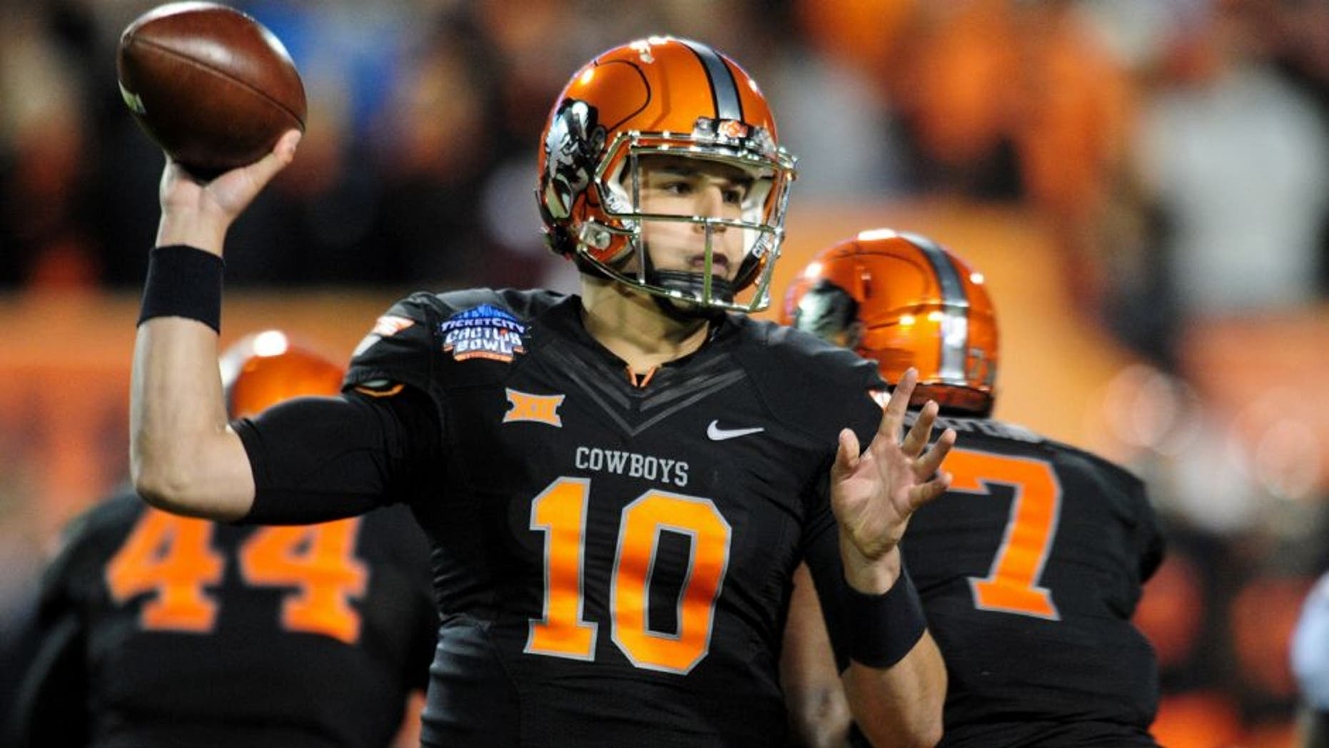 Jan 2, 2015; Tempe, AZ, USA; Oklahoma State Cowboys quarterback Mason Rudolph (10) throws during the first half against the Washington Huskies in the 2015 Cactus Bowl at Sun Devil Stadium. Mandatory Credit: Matt Kartozian-USA TODAY Sports