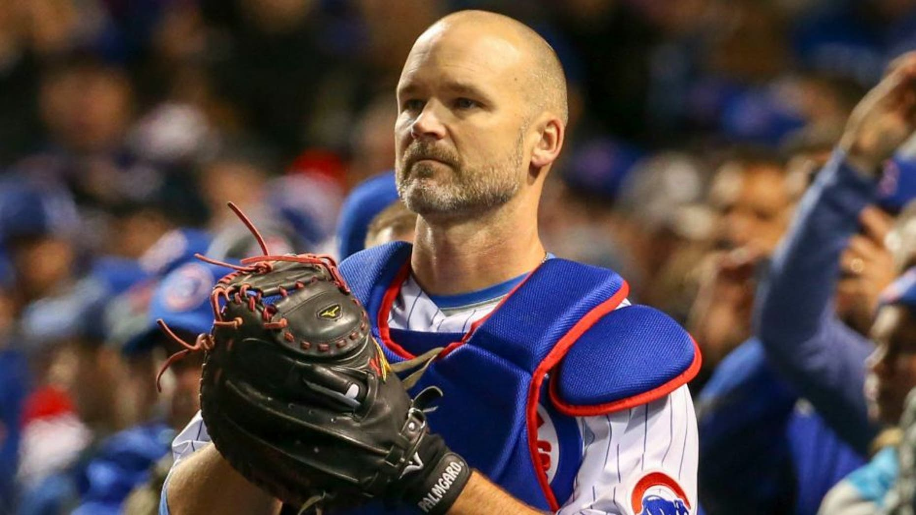 Oct 30, 2016; Chicago, IL, USA; Chicago Cubs catcher David Ross (3) stands in the dugout before game five of the 2016 World Series against the Cleveland Indians at Wrigley Field. Mandatory Credit: Jerry Lai-USA TODAY Sports