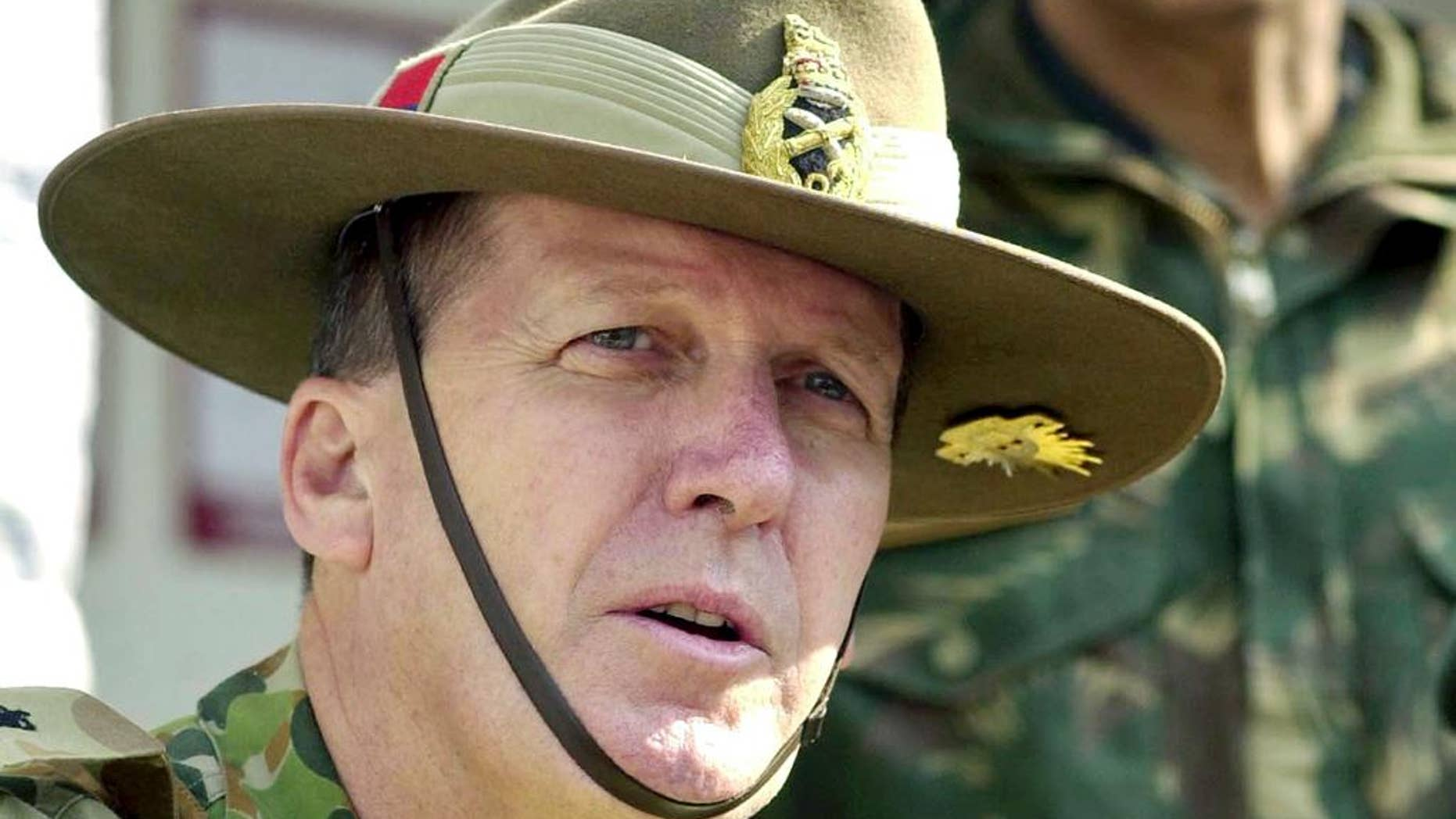 "FILE - In this Nov. 23, 2004, file photo, Australian Army Chief Lt. Gen. Peter Leahy speaks at a press conference in Srinagar, India. Now former Australian army chief Leahy on Thursday, July 7, 2016, warned Australia against ""blindly going along with"" the United States after the Chilcot inquiry was critical of Britain's involvement in the Iraq war. (AP Photo/Mukhtar Khan, File)"