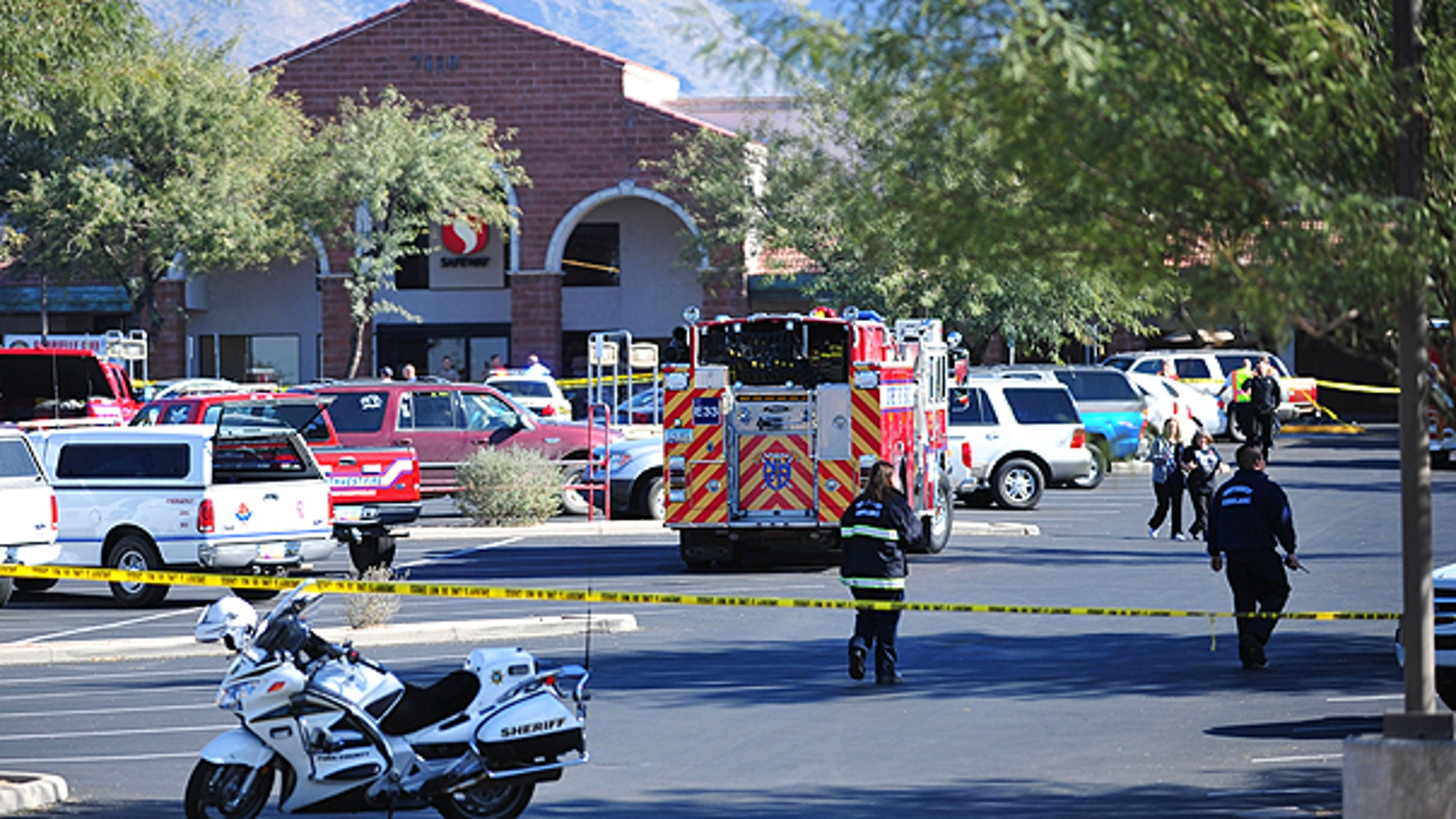 Jan. 8: Emergency officials work at the scene of a shooting that authorities claim involved Rep. Gabrielle Giffords, D-Ariz., at a Safeway grocery store in Tucson, Ariz.