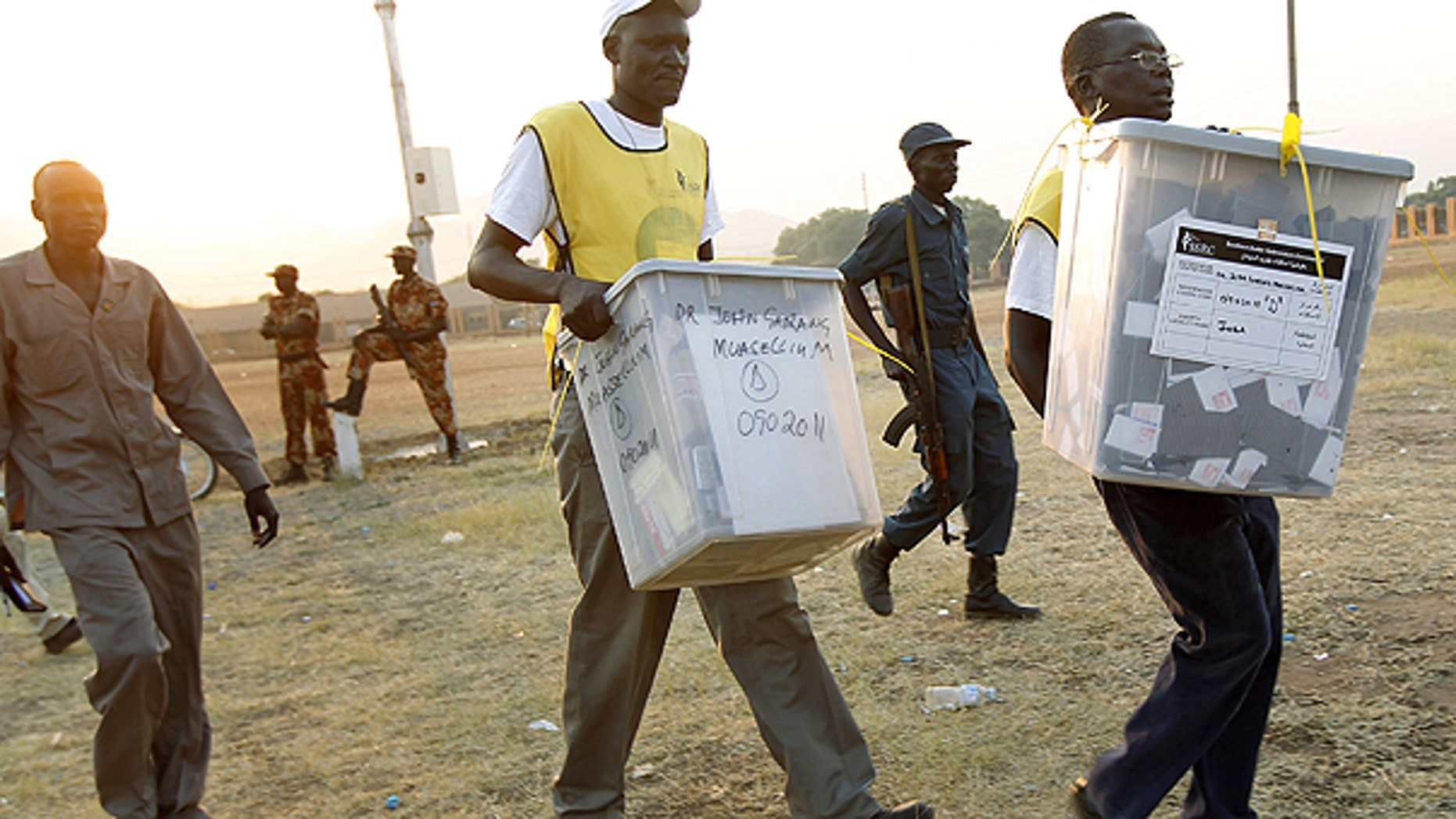 Jan. 15: Election officials carry ballot boxes moments after polls closed in Juba, Southern Sudan.