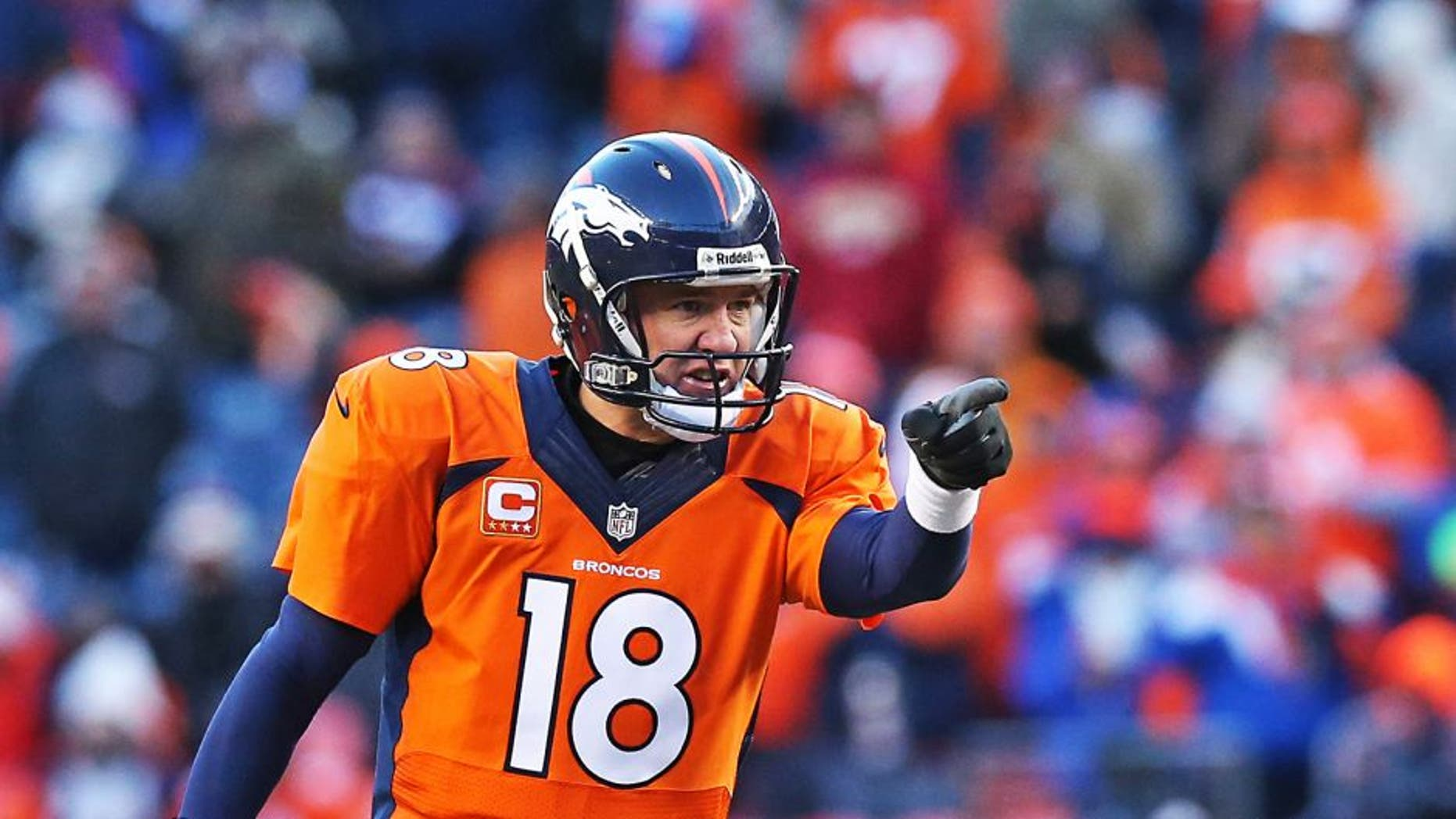 Jan 12, 2014; Denver, CO, USA; Denver Broncos quarterback Peyton Manning (18) points and signals prior to the snap against the San Diego Chargers during the 2013 AFC divisional playoff football game at Sports Authority Field at Mile High. Mandatory Credit: Matthew Emmons-USA TODAY Sports