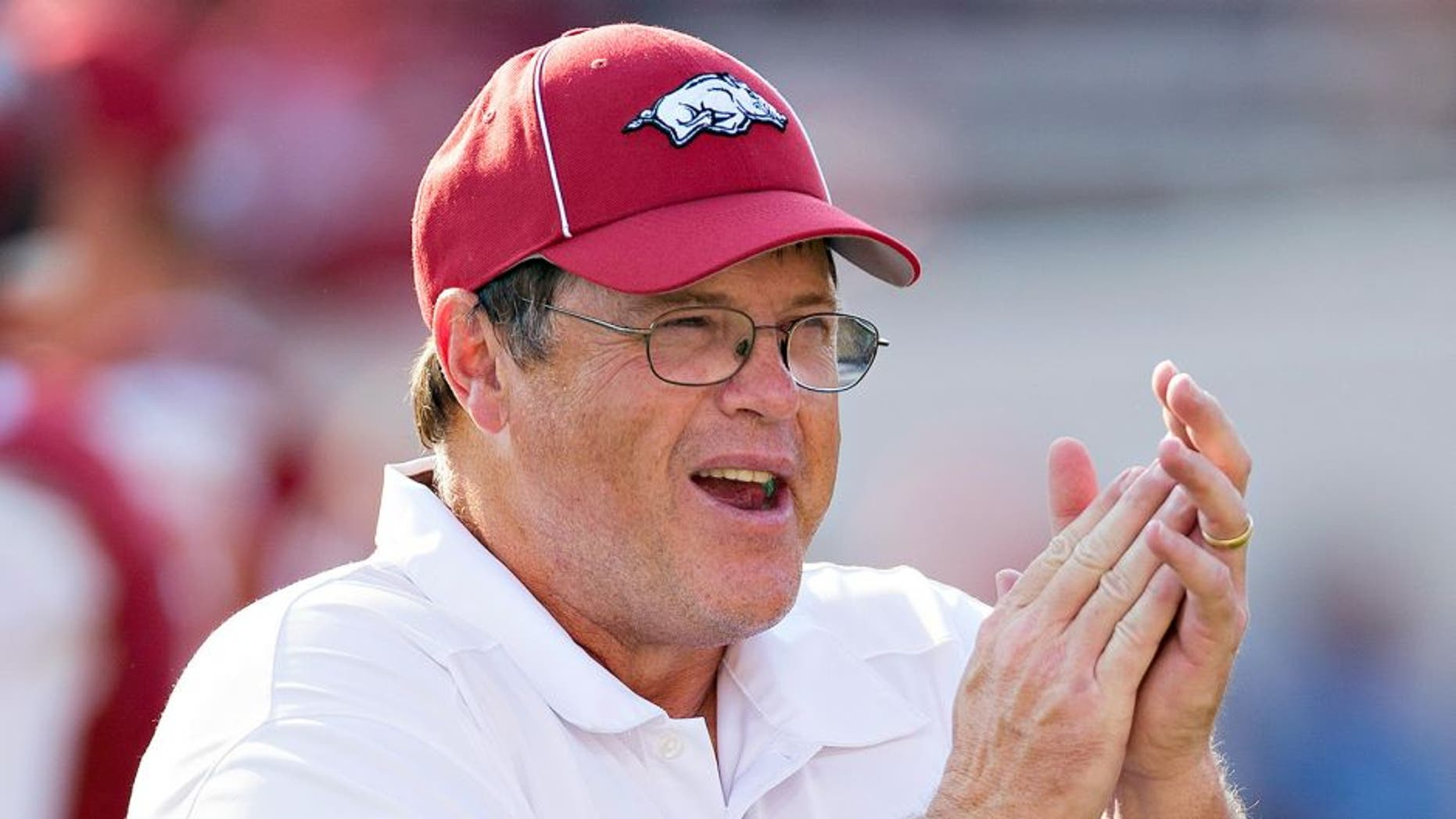 LITTLE ROCK, AR - SEPTEMBER 7: Offensive Coordinator Jim Chaney of the Arkansas Razorbacks watches the team warm up before a game against the Samford Bulldogs at War Memorial Stadium on September 7, 2013 in Little Rock, Arkansas. The Razorbacks defeated the Bulldogs 31-21. (Photo by Wesley Hitt/Getty Images)
