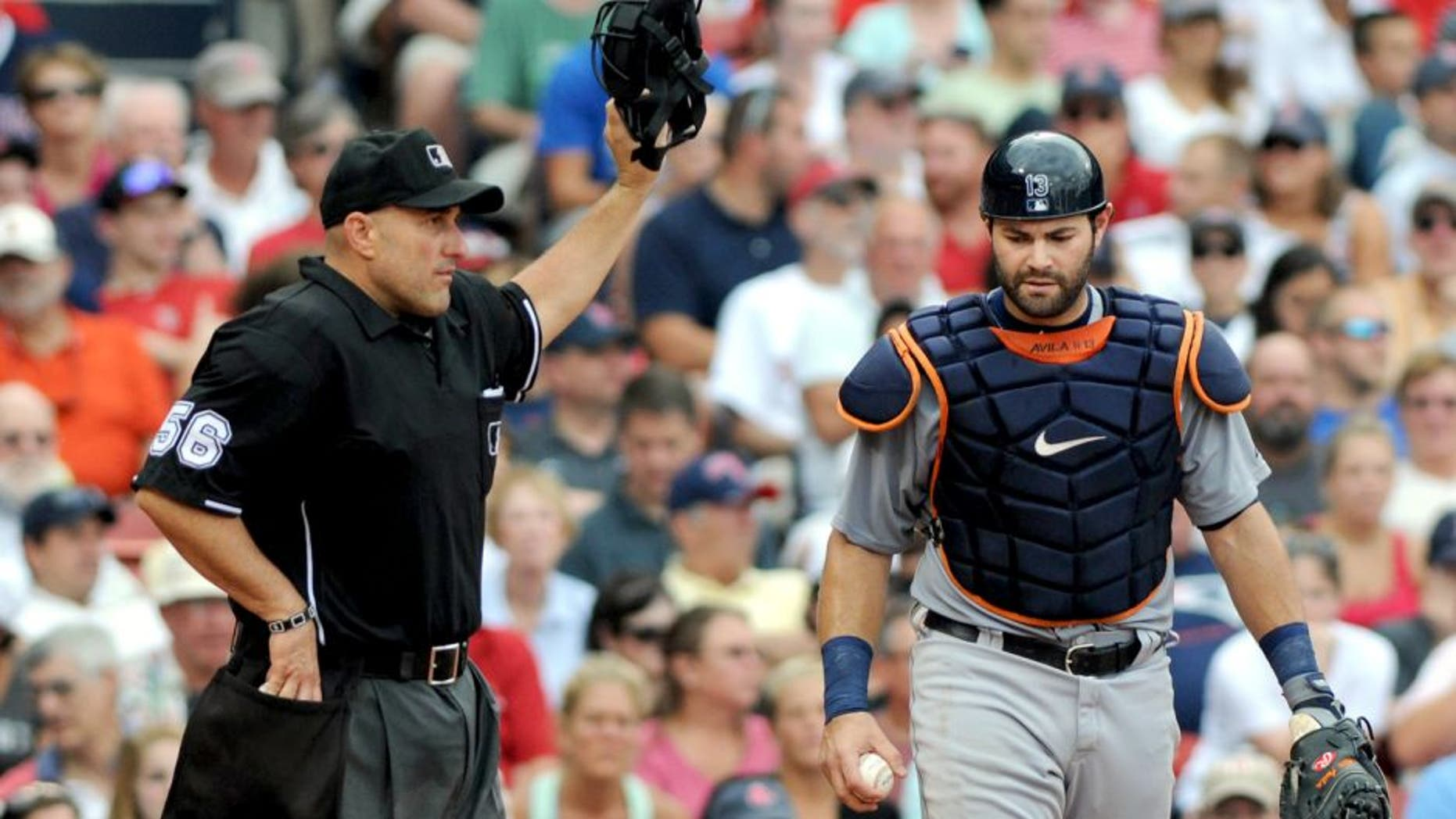 BOSTON, MA - SEPTEMBER 2: Alex Avila #13 of the Detroit Tigers calls for timeout from homeplate umpire Eric Cooper #56 in the seventh inning against the Boston Red Sox at Fenway Park on September 2, 2013 in Boston, Massachusetts. The Tigers won 3-0. (Photo by Darren McCollester/Getty Images)
