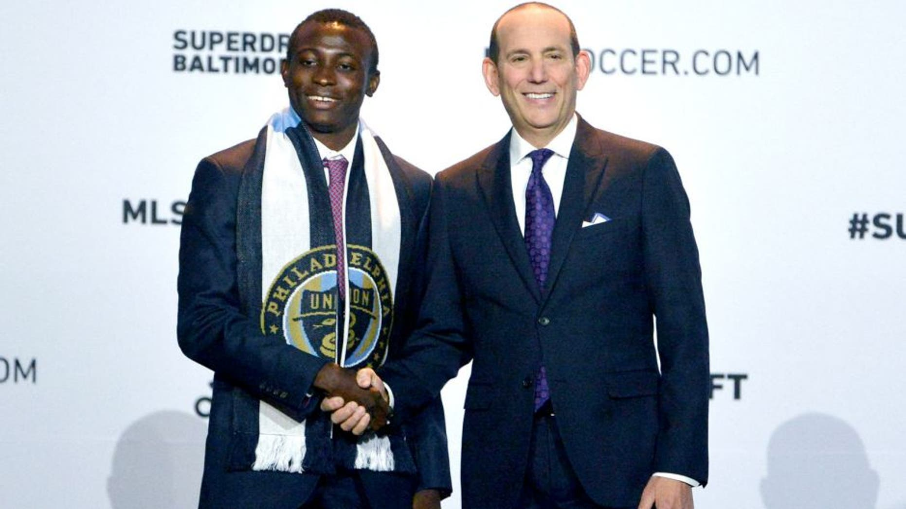 Jan 14, 2016; Baltimore, MD, USA; Joshua Yaro shakes hands with commissioner Don Garber after being selected number two overall by the Philadelphia Union during the 2016 MLS SuperDraft at Baltimore Convention Center. Mandatory Credit: Tommy Gilligan-USA TODAY Sports