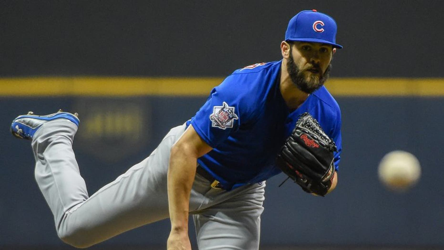 Oct 2, 2015; Milwaukee, WI, USA; Chicago Cubs pitcher Jake Arrieta (49) pitches in the first inning against the Milwaukee Brewers at Miller Park. Mandatory Credit: Benny Sieu-USA TODAY Sports