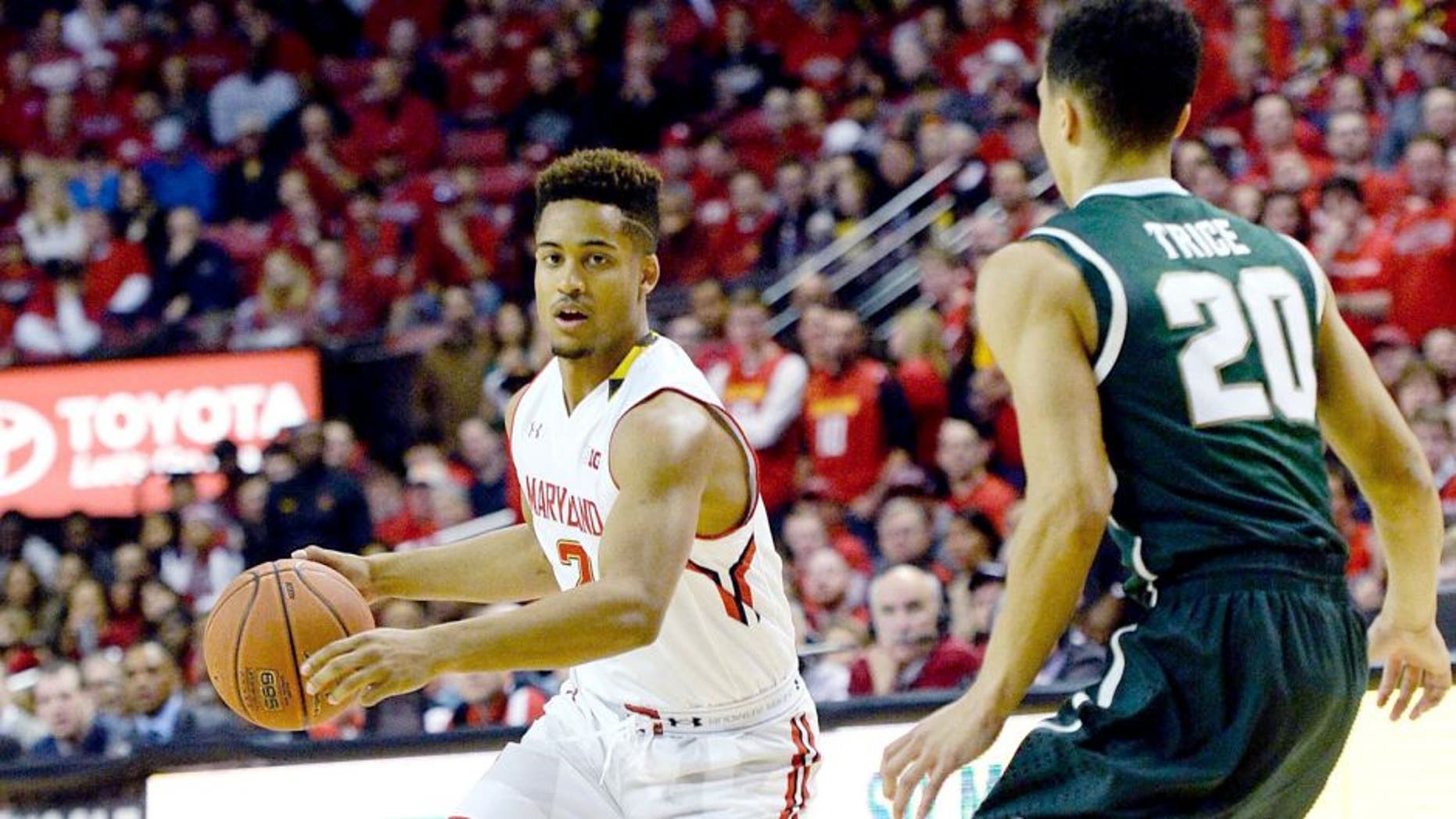 Jan 17, 2015; College Park, MD, USA; Maryland Terrapins guard Melo Trimble (2) dribbles as Michigan State Spartans guard Travis Trice (20) defends during the first half at Xfinity Center. Mandatory Credit: Tommy Gilligan-USA TODAY Sports
