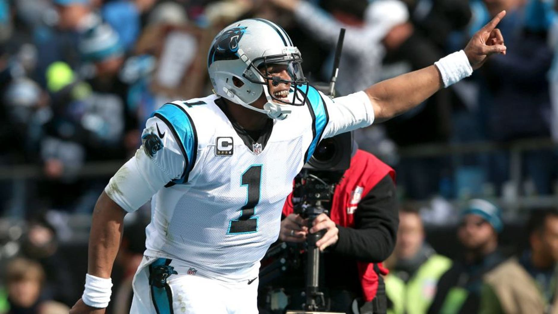 CHARLOTTE, NC - JANUARY 17: Cam Newton #1 of the Carolina Panthers celebrates after a touchdown during the NFC Divisional Playoff Game against the Seattle Seahawks at Bank of America Stadium on January 17, 2016 in Charlotte, North Carolina. (Photo by Streeter Lecka/Getty Images)
