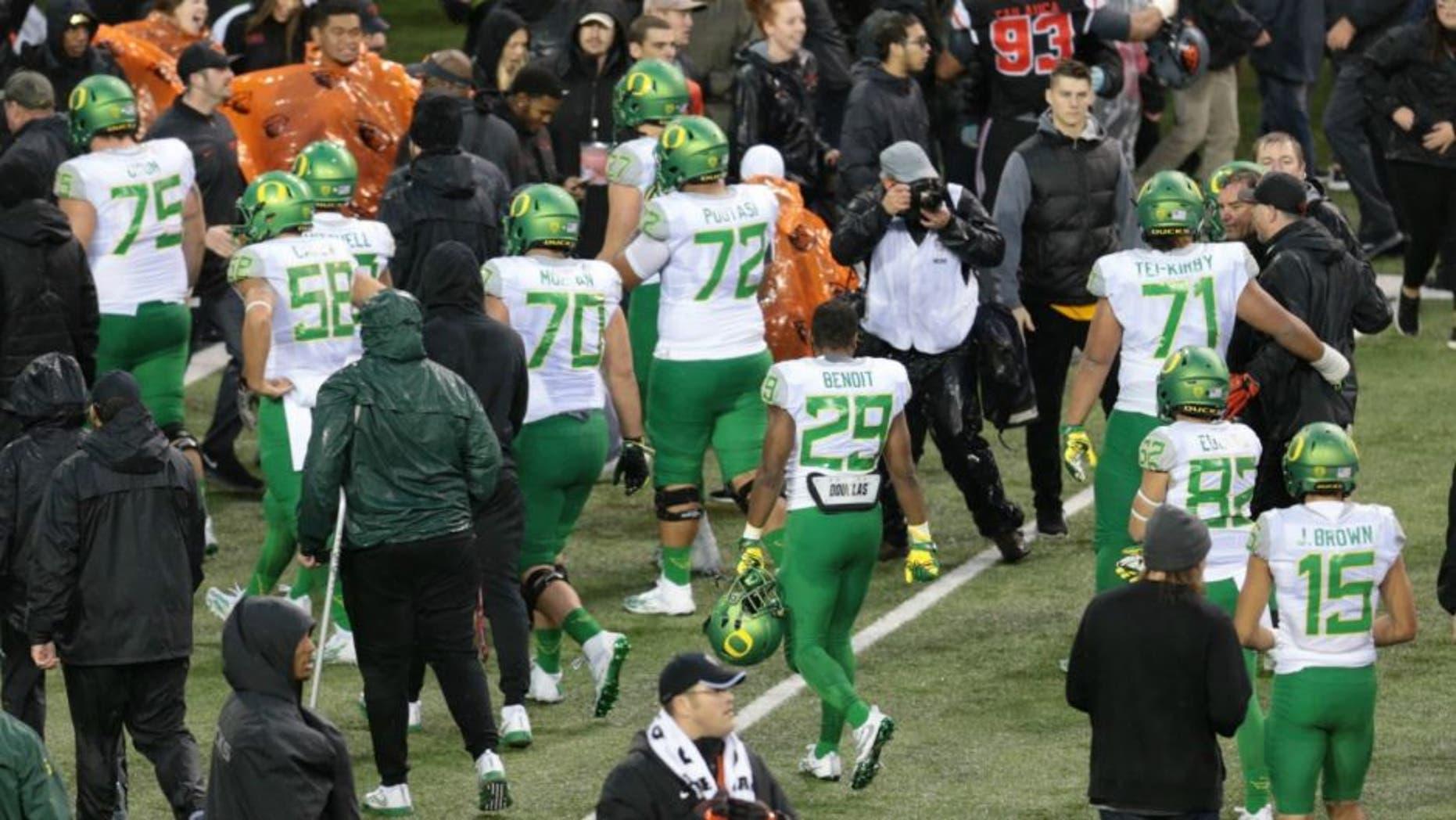 Nov 26, 2016; Corvallis, OR, USA; Oregon Ducks players walk off the field following a lose (24-34) Oregon State Beavers at Reser Stadium. Mandatory Credit: Scott Olmos-USA TODAY Sports