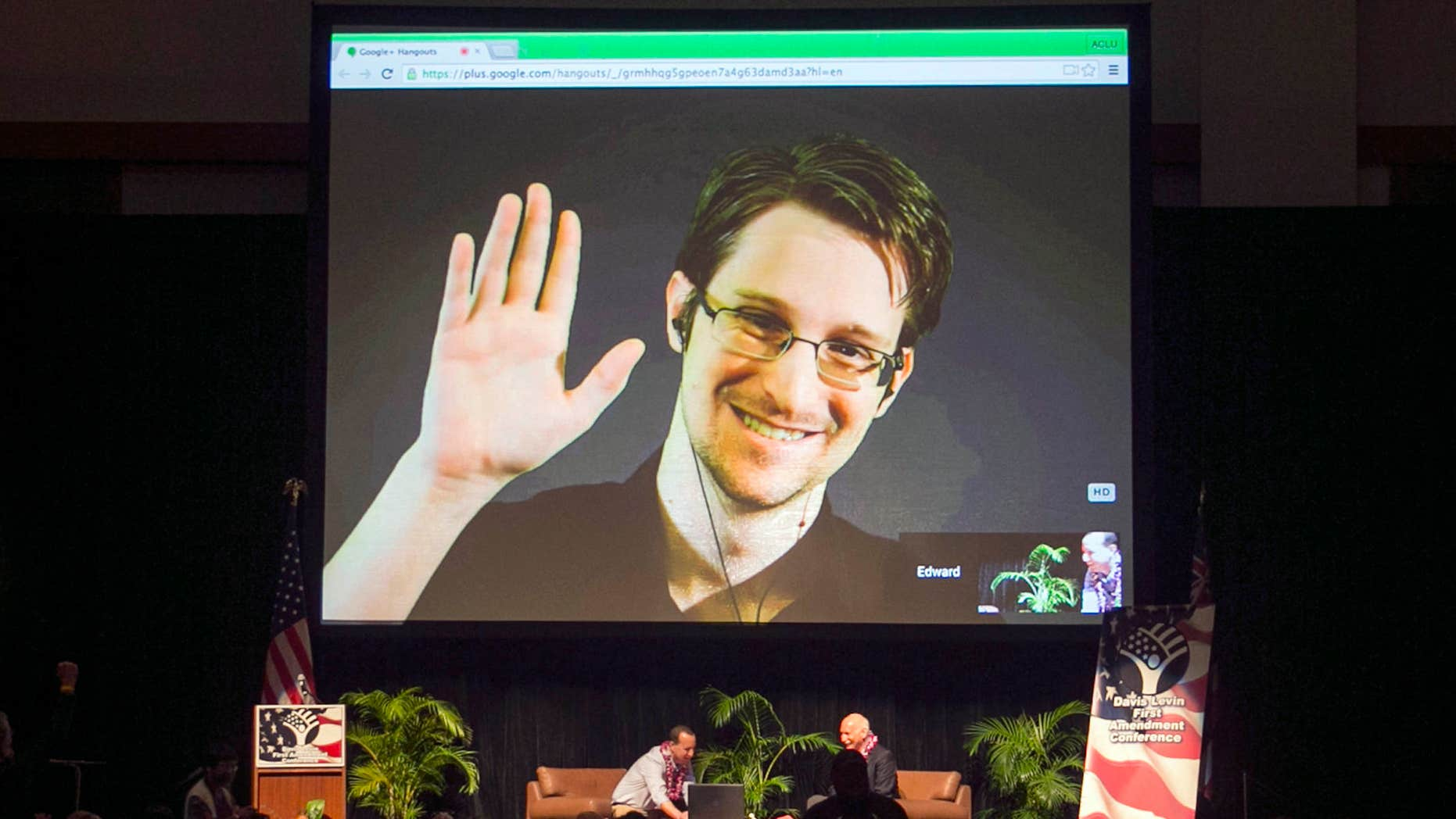 FILE - In this Feb. 14, 2015 file photo, Edward Snowden appears on a live video feed broadcast from Moscow at an event sponsored by ACLU Hawaii in Honolulu.