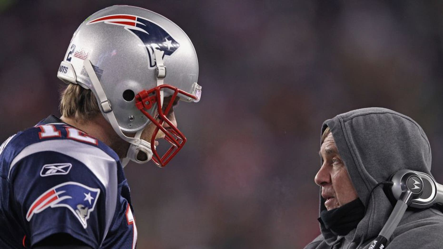 FOXBORO, MA - JANUARY 14: (L-R) Tom Brady #12 of the New England Patriots talks with head coach Bill Belichick on the sideline against the Denver Broncos during their AFC Divisional Playoff Game at Gillette Stadium on January 14, 2012 in Foxboro, Massachusetts. (Photo by Elsa/Getty Images)