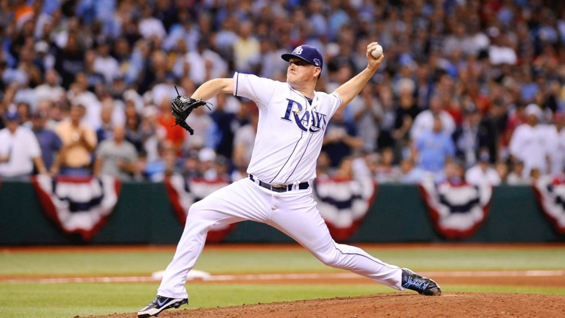 ST PETERSBURG, FL - OCTOBER 07: Jake McGee #57 of the Tampa Bay Rays pitches in the eighth inning against the Boston Red Sox during Game Three of the American League Division Series at Tropicana Field on October 7, 2013 in St Petersburg, Florida. (Photo by Brian Blanco/Getty Images)