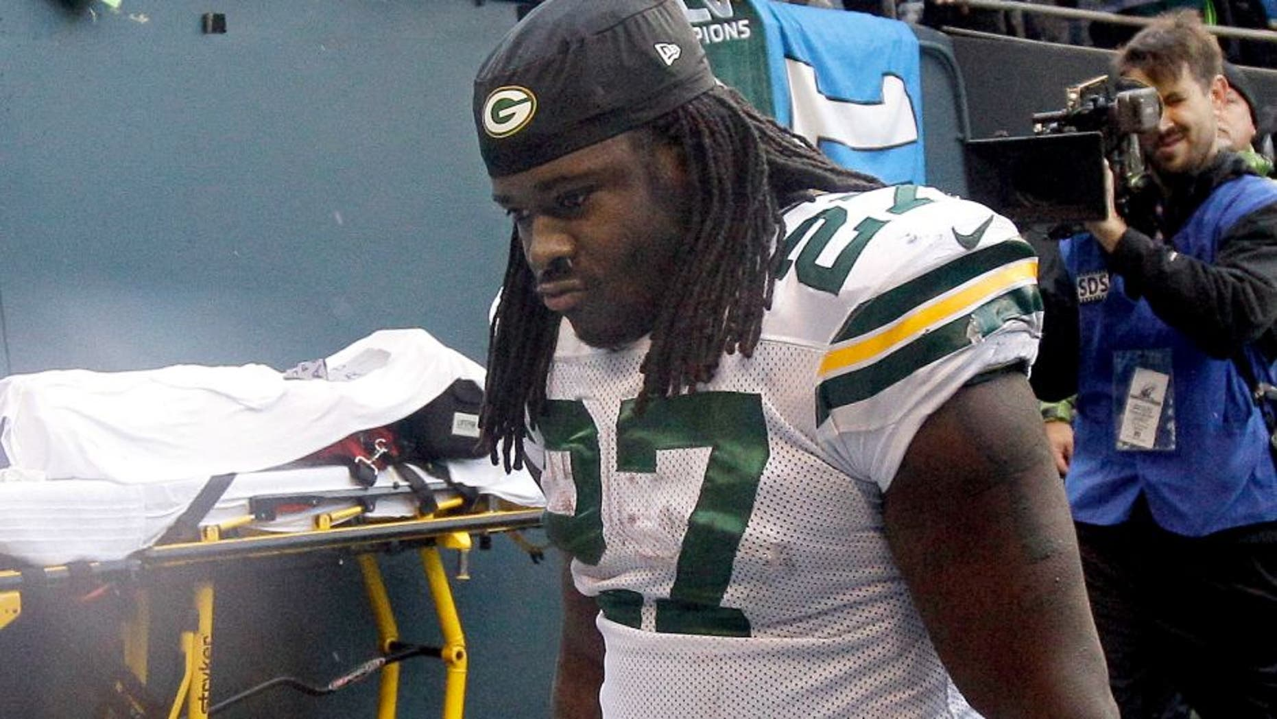 Green Bay Packers' Eddie Lacy looks down as he walks off the field after overtime of the NFL football NFC Championship game against the Seattle Seahawks Sunday, Jan. 18, 2015, in Seattle. The Seahawks won 28-22 to advance to Super Bowl XLIX. (AP Photo/Jeff Chiu)