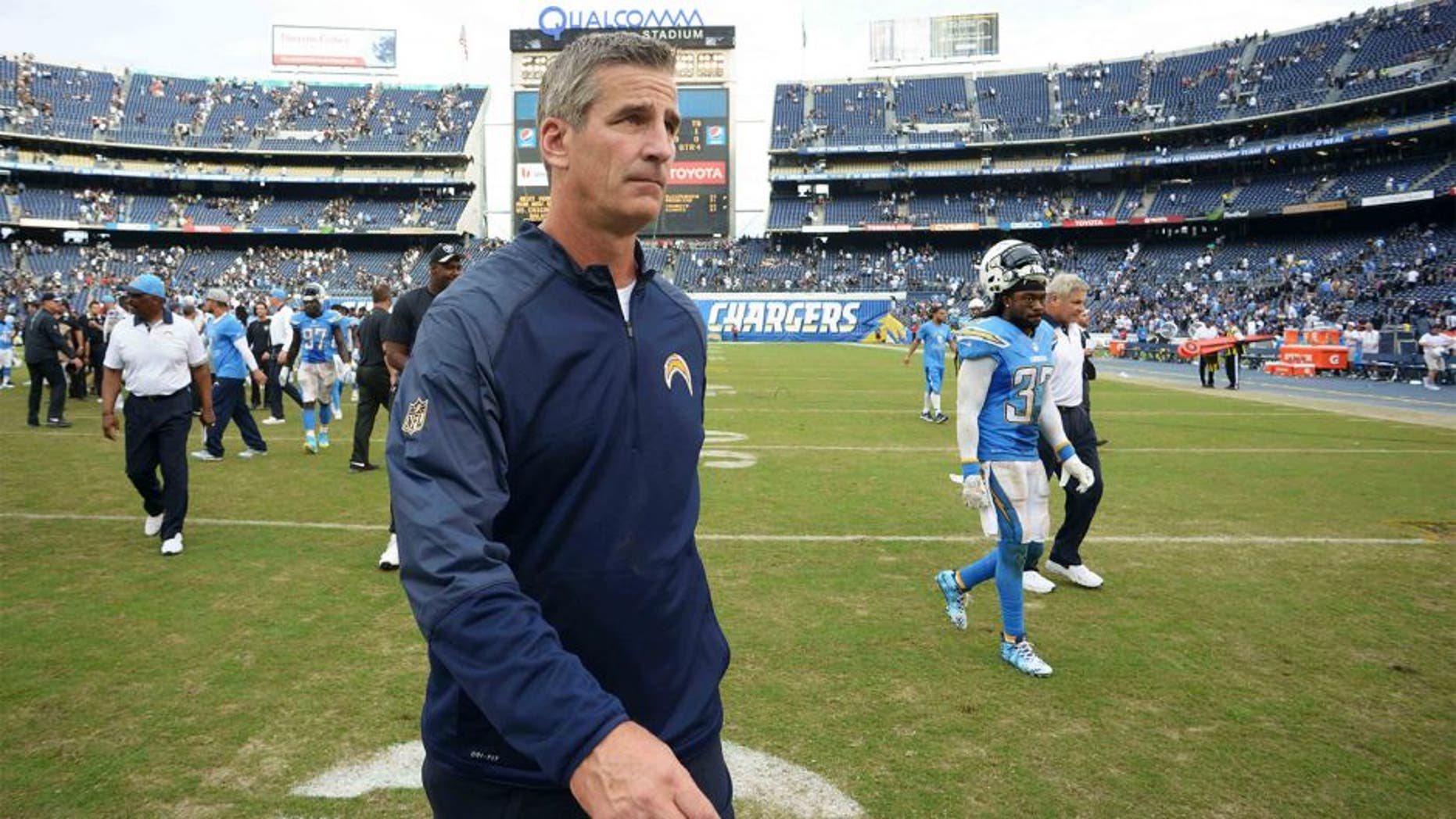 Oct 25, 2015; San Diego, CA, USA; San Diego Chargers offensive coordinator Frank Reich walks off the field after the Chargers lost to the Oakland Raiders 39-27 at Qualcomm Stadium. Mandatory Credit: Jake Roth-USA TODAY Sports