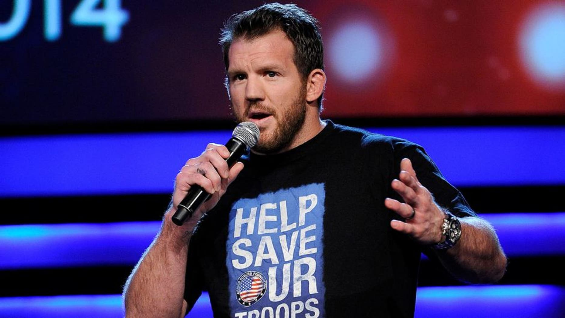 """LAS VEGAS, NV - FEBRUARY 19: Mixed martial artist Ryan Bader speaks during the """"Ron White's Comedy Salute to the Troops 2014"""" at The Mirage Hotel & Casino on February 19, 2014 in Las Vegas, Nevada. (Photo by David Becker/WireImage)"""
