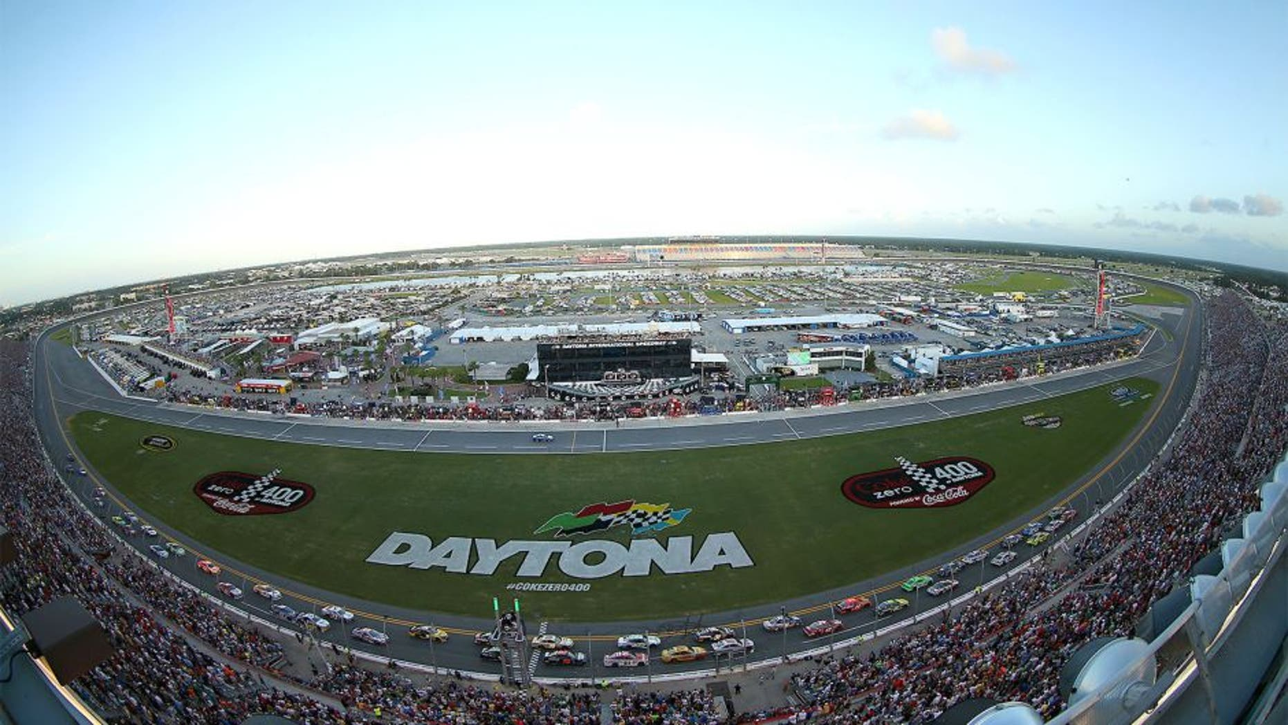 DAYTONA BEACH, FL - JULY 06: (Lead cars from top) Kyle Busch, driver of the #18 Interstate Batteries Toyota and Matt Kenseth, driver of the #20 Home Depot / Husky Toyota, lead the field at the start of the NASCAR Sprint Cup Series Coke Zero 400 at Daytona International Speedway on July 6, 2013 in Daytona Beach, Florida. (Photo by Mike Ehrmann/Getty Images)