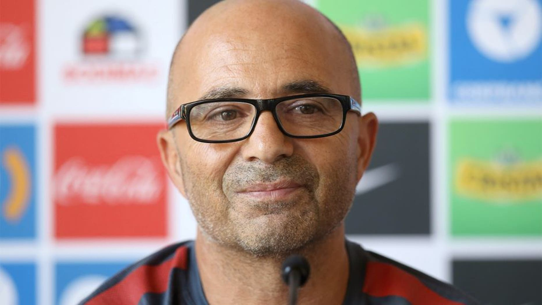 "Chilean national football team, Argentinian Jorge Sampaoli, gestures as he speaks during a press conference in Santiago, Chile, on January 13, 2016. Chile coach Jorge Sampoali appears on the verge of quitting six months after guiding La Roja to the Copa America, with the Argentine claiming he is being held ""hostage"" by the federation. AFP PHOTO/CLAUDIO REYES / AFP / Claudio Reyes (Photo credit should read CLAUDIO REYES/AFP/Getty Images)"