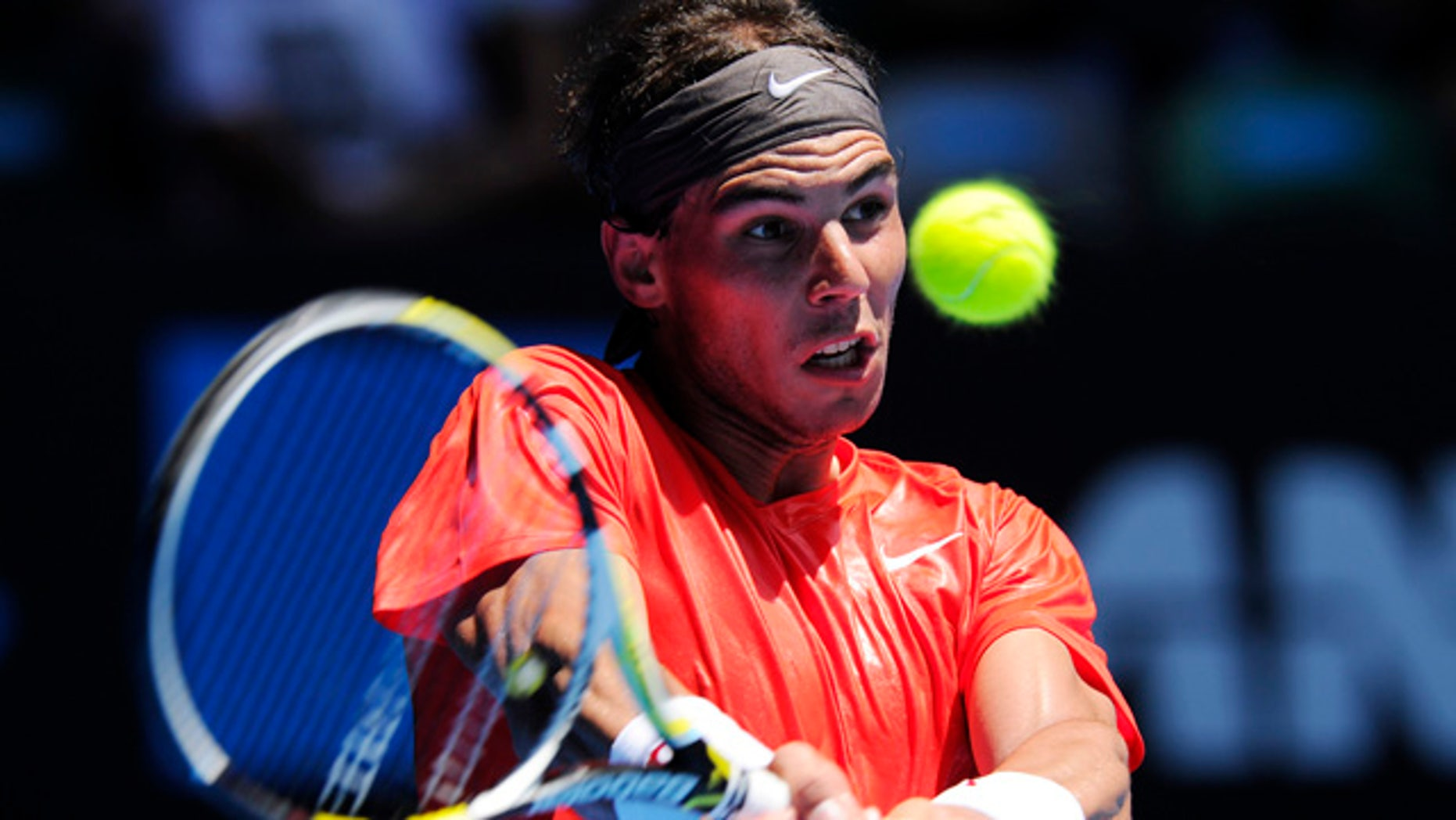 Jan. 20: Spain's Rafael Nadal makes a backhand return to Ryan Sweeting of the U.S. during their second round match at the Australian Open tennis championships in Melbourne, Australia.